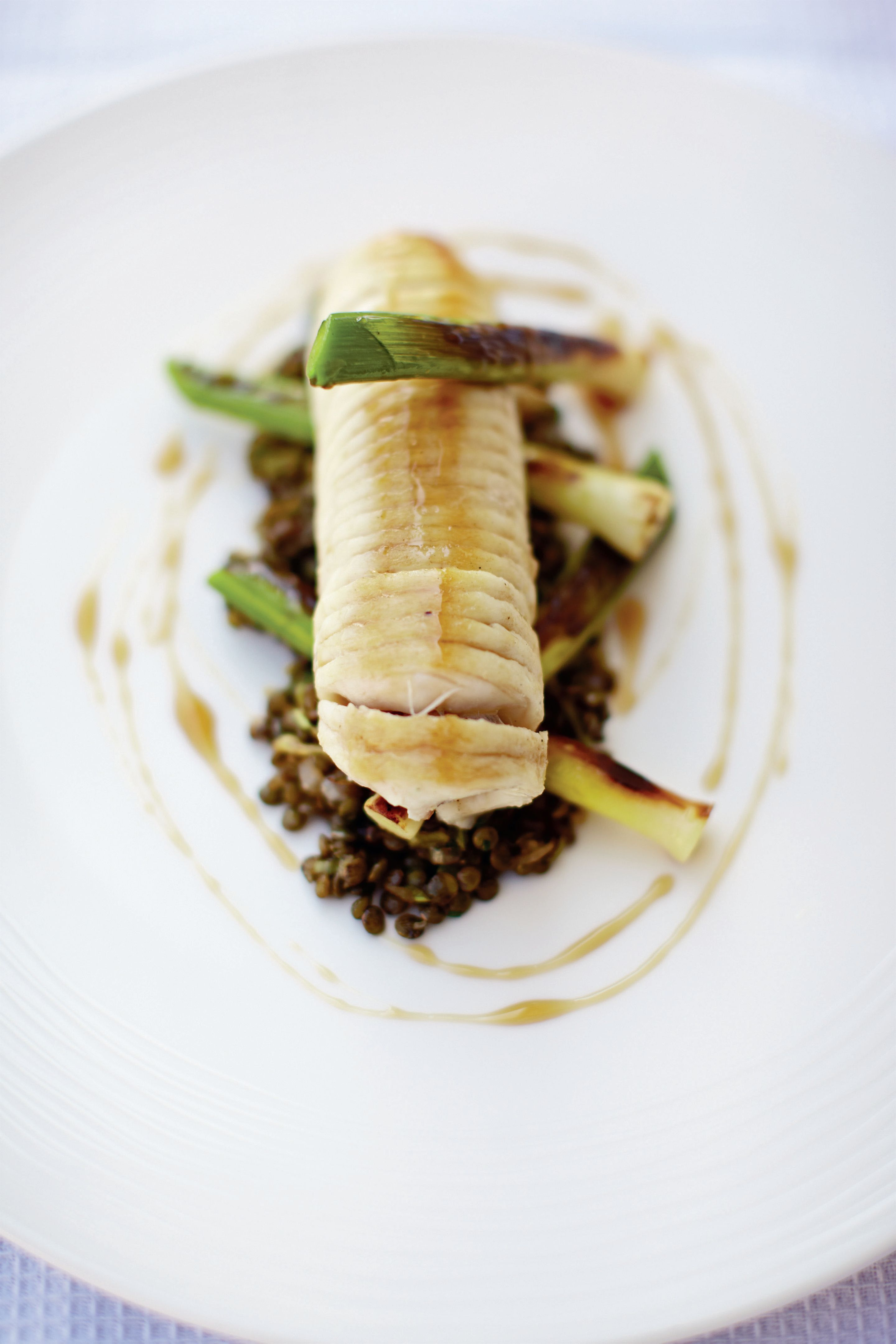 Poached ray with leeks, lentils and sherry vinegar