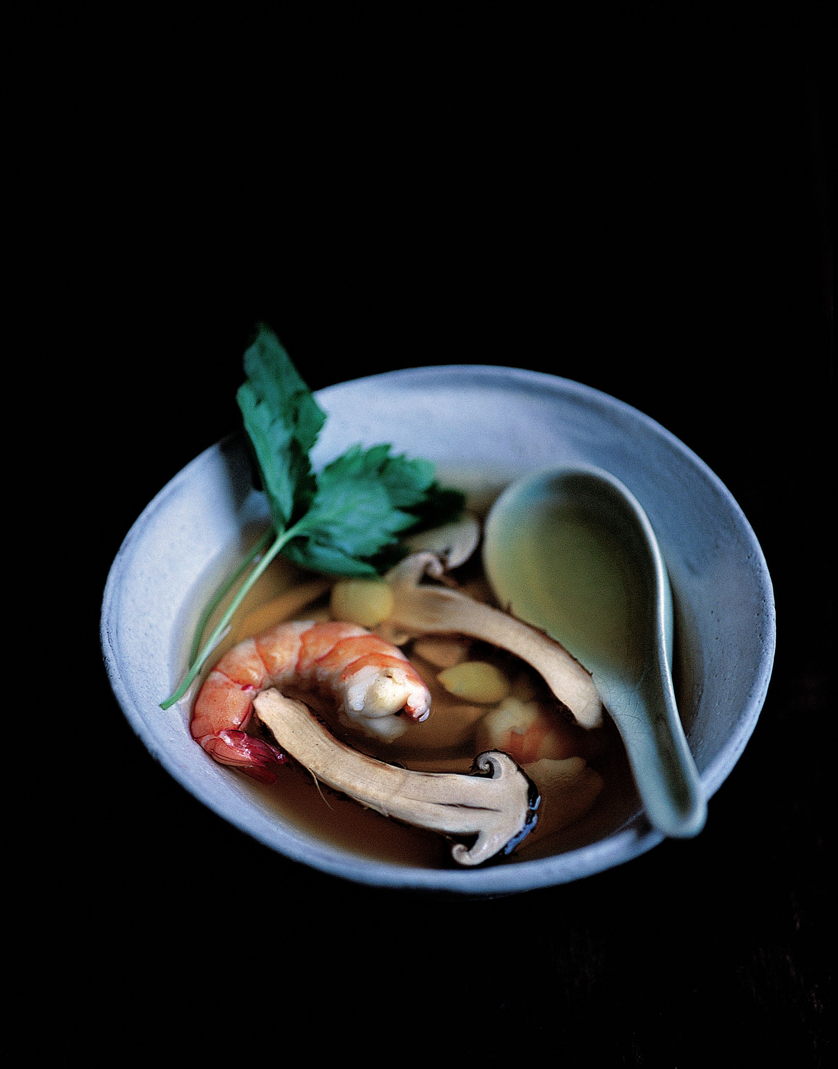 Hot Thai soup of oyster mushrooms and prawns