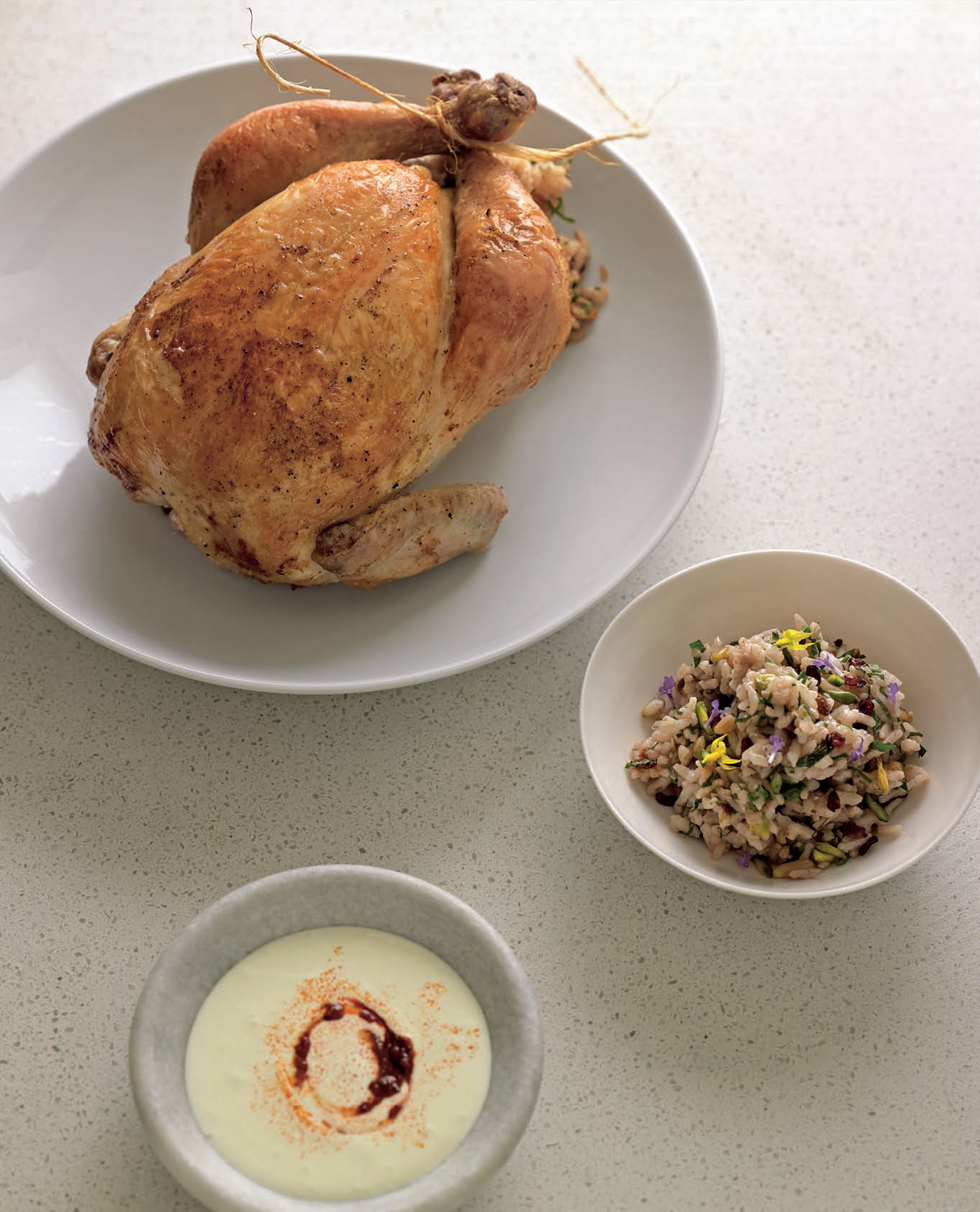 Roast chicken with pine nut and barberry rice stuffing