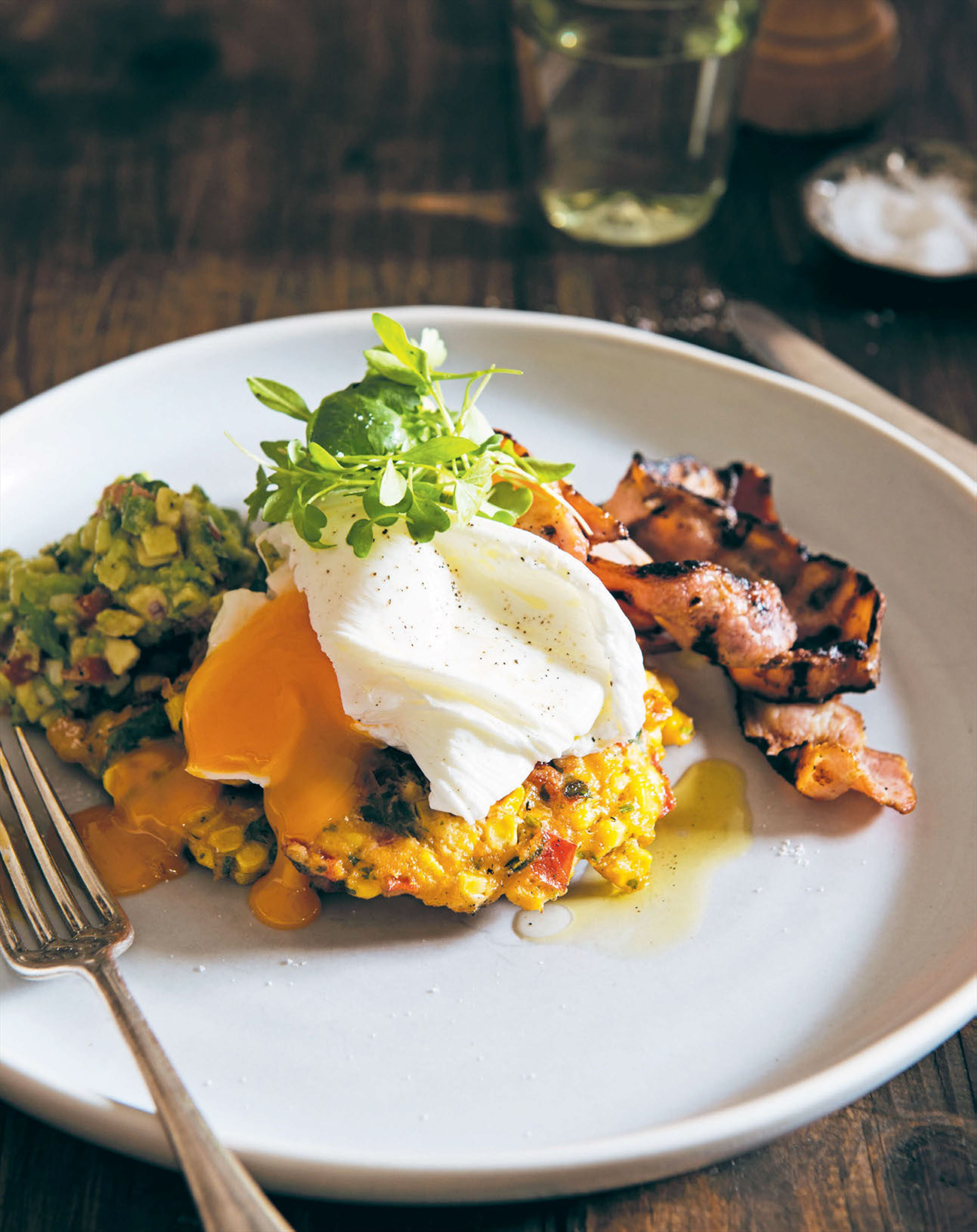 Corn cakes with grilled bacon, avocado salsa & poached eggs