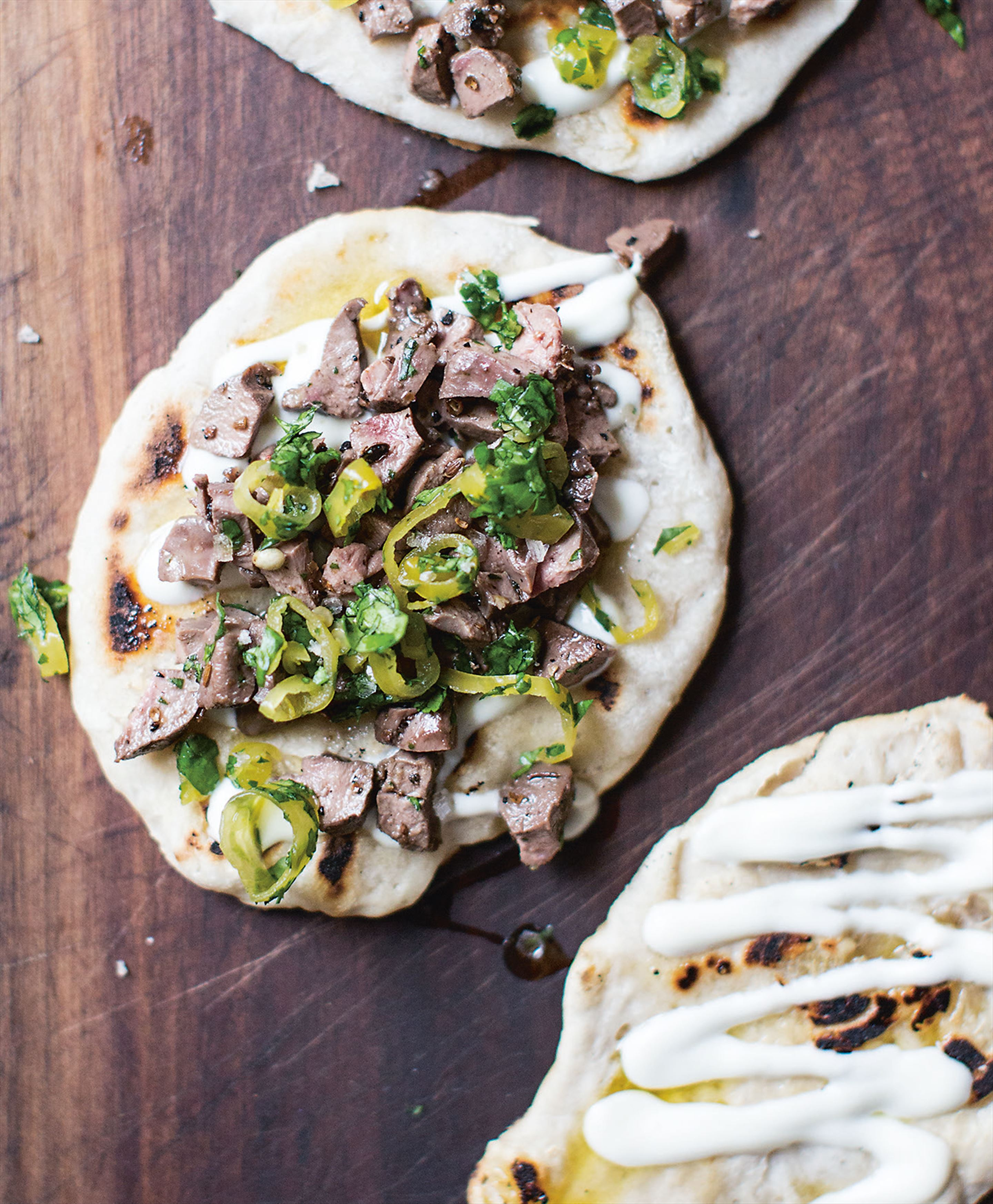 Sourdough flatbread with cumin lamb & kebab chillies