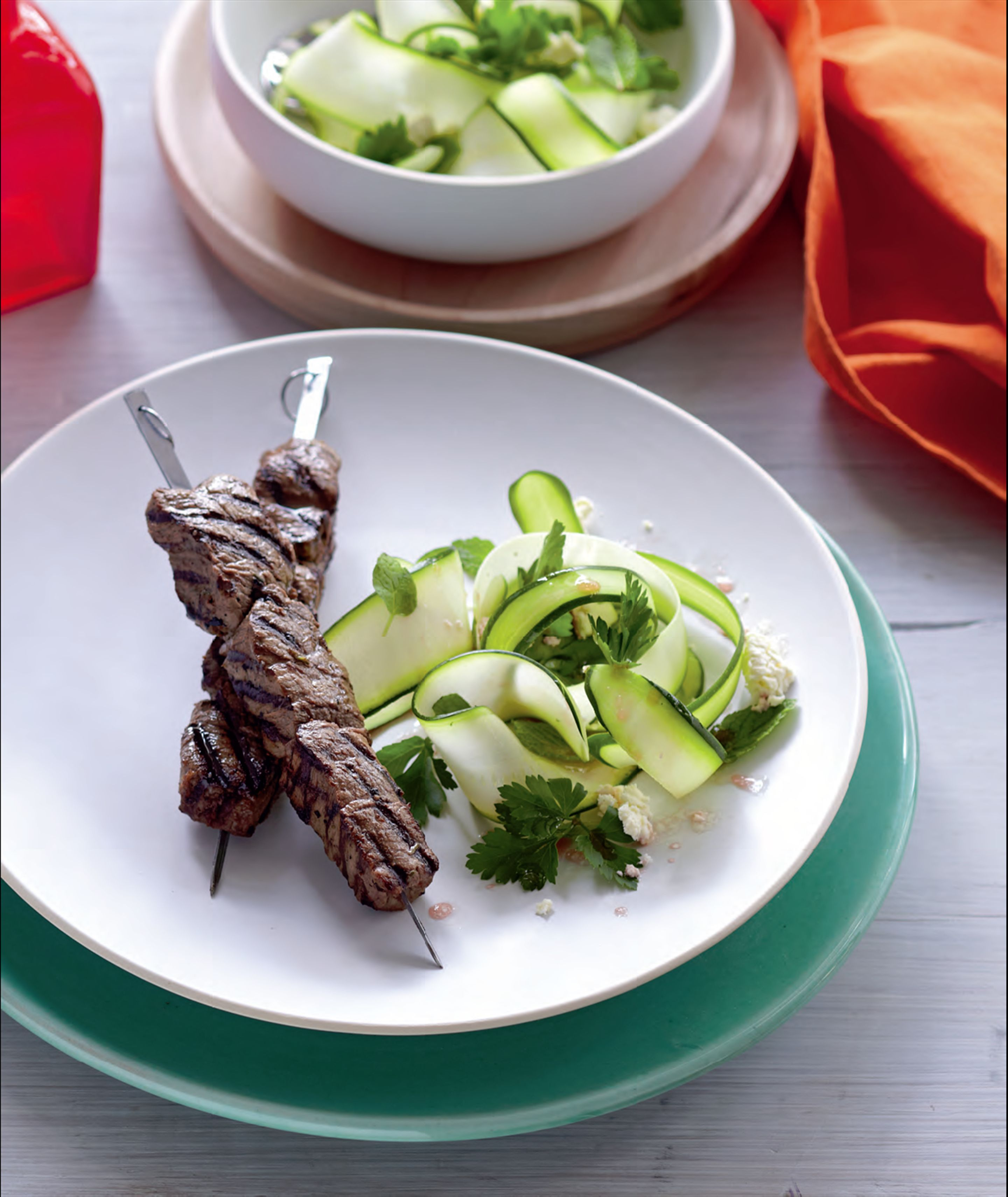 Beef skewers with zucchini salad