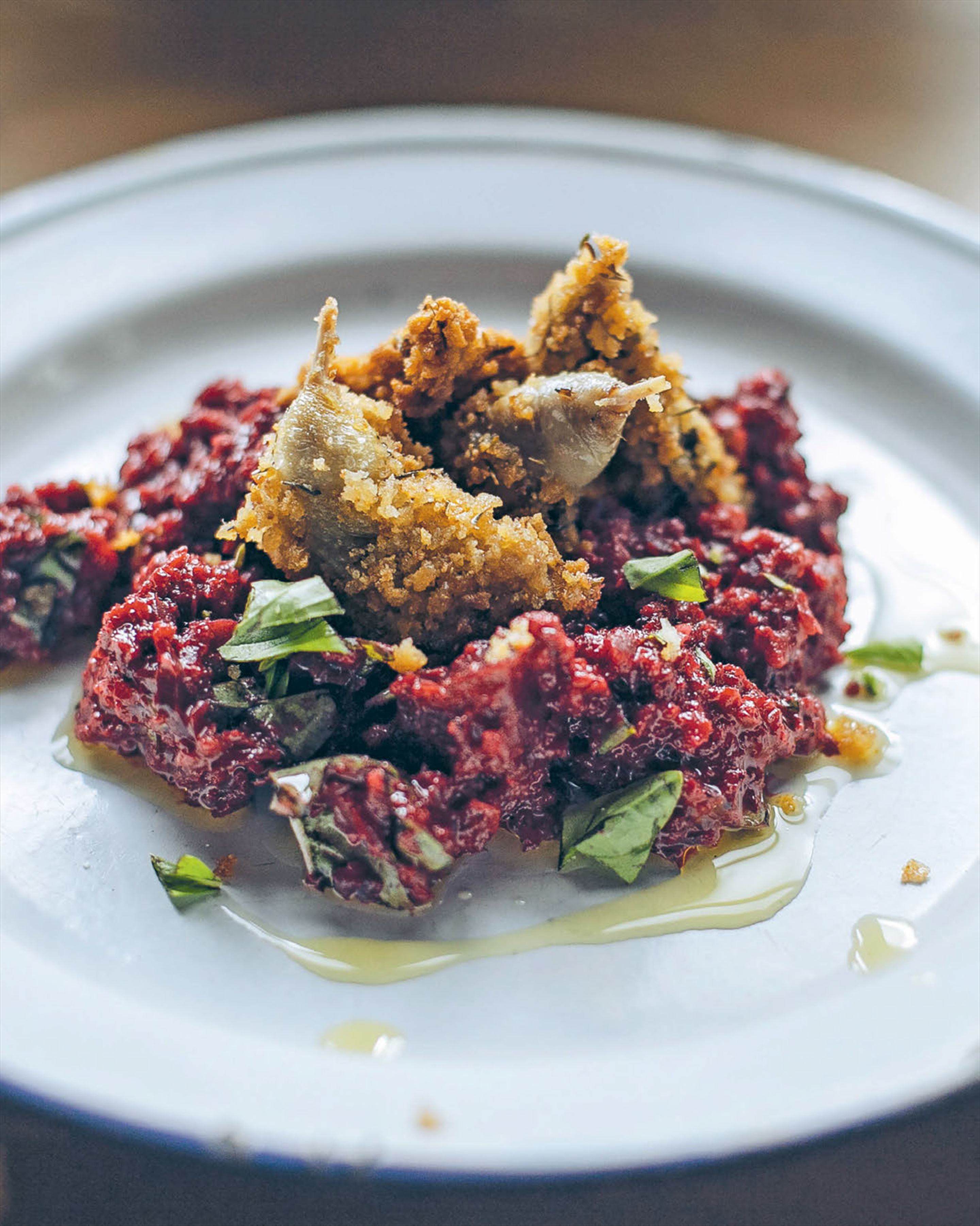 Thyme-crumbed quail with roast beetroot mash