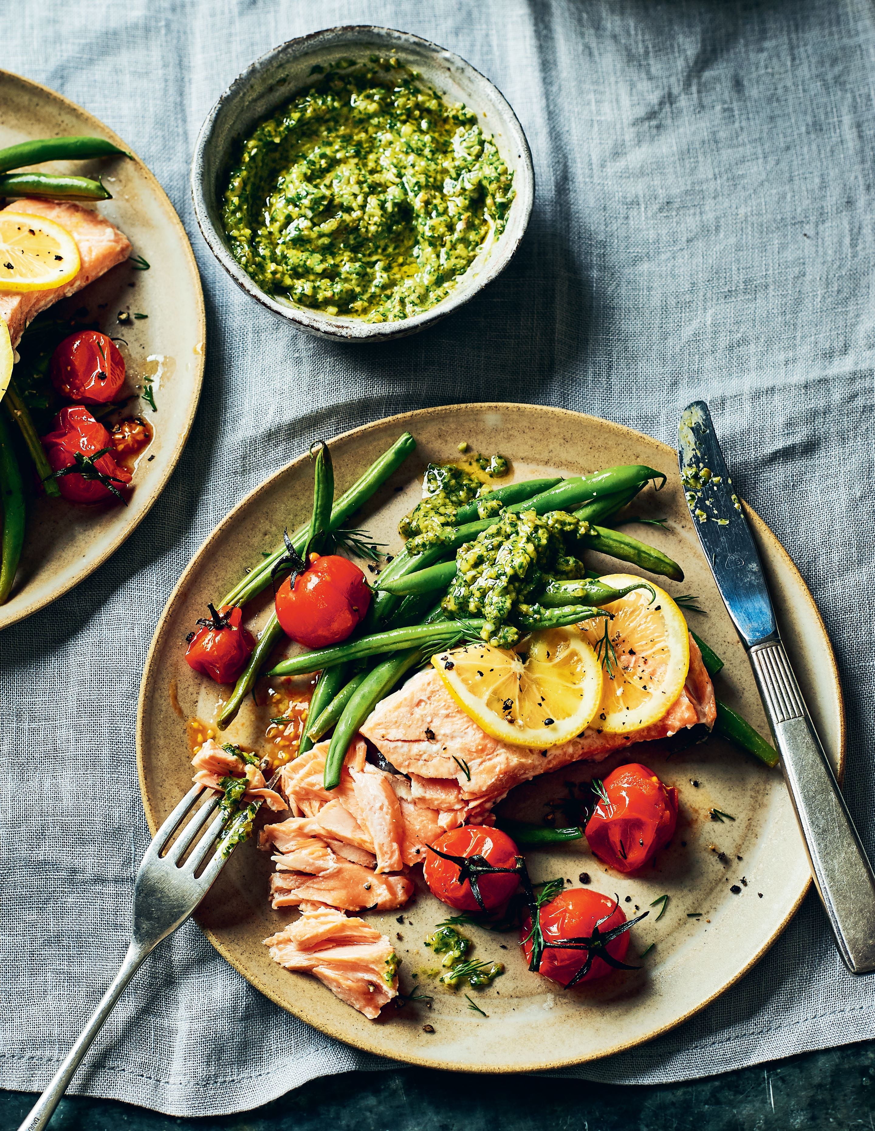 Salmon fillets with vine tomatoes, beans and green sauce