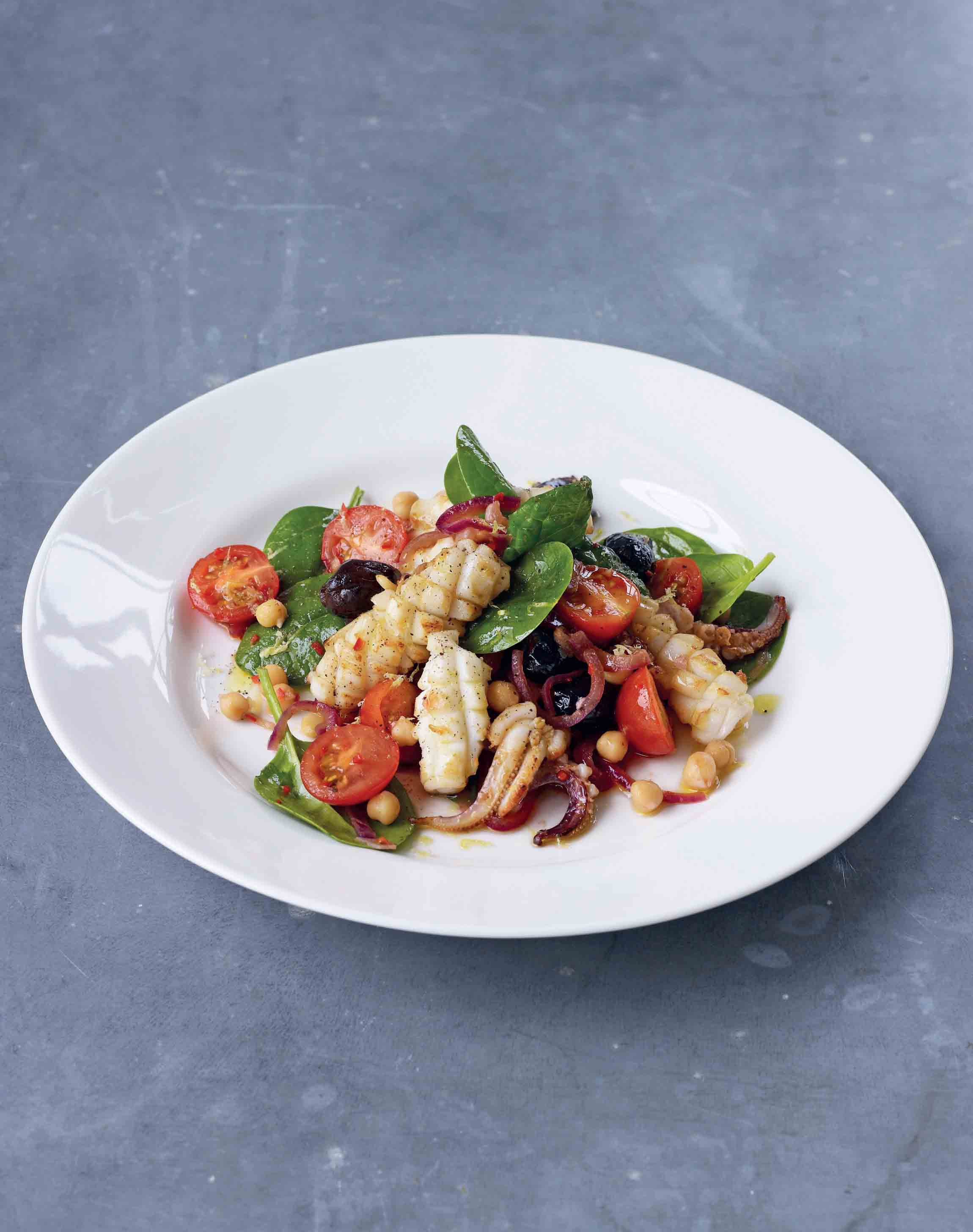 Pan-fried squid with chickpea, tomato, olive and chilli salad