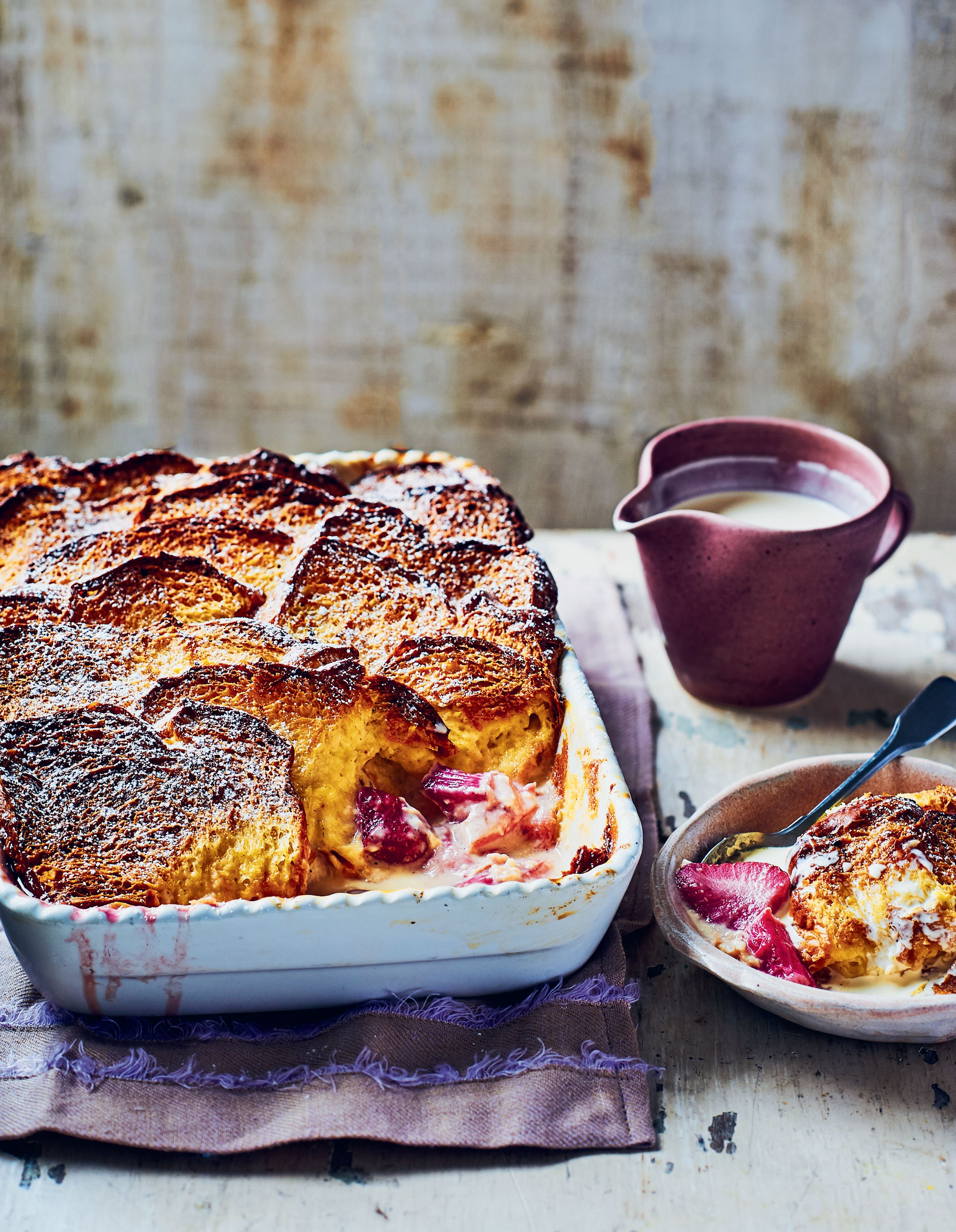 Strawberry and rhubarb brioche pudding