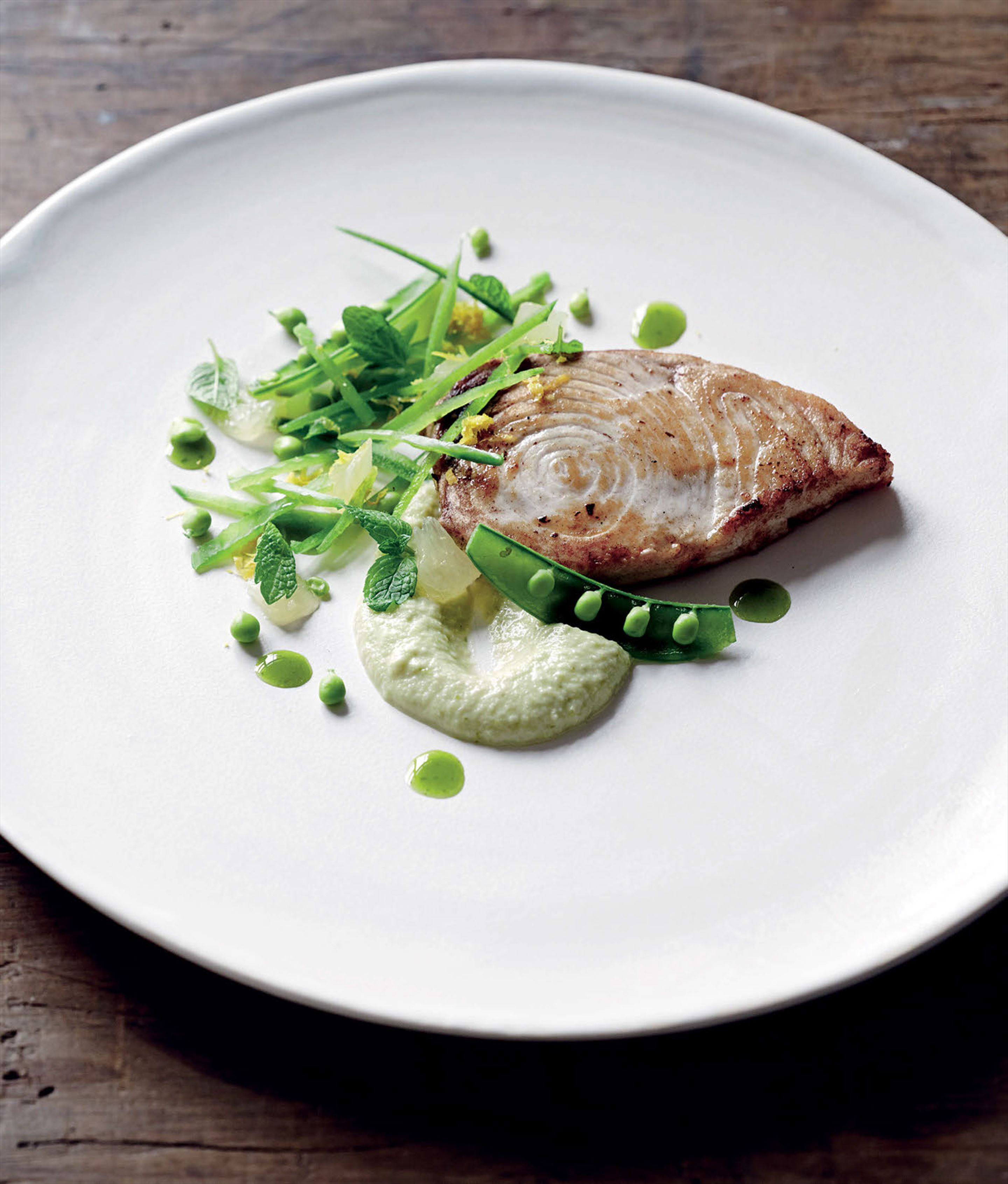 Pan-fried swordfish with minted pea and lemon salad