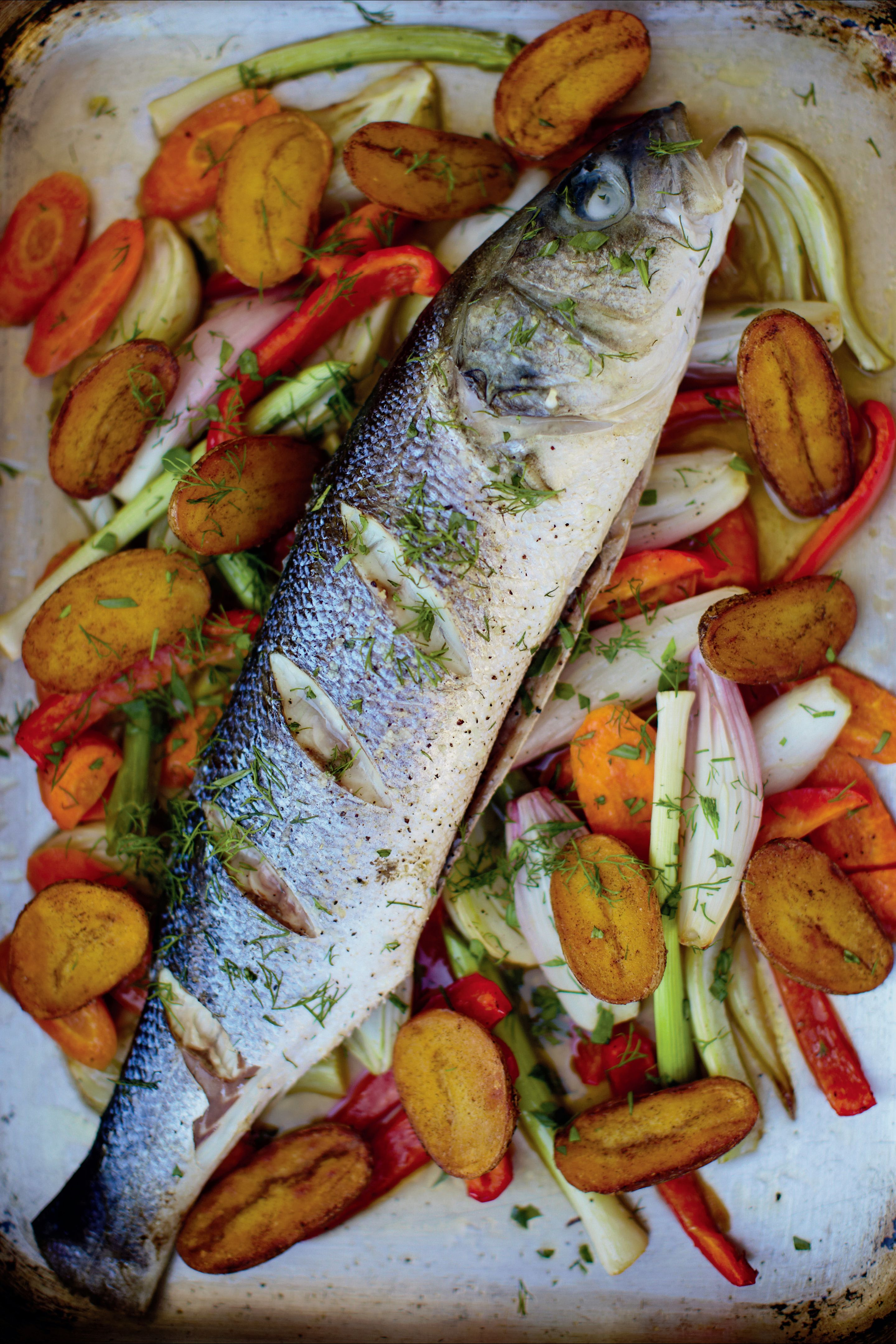 Baked sea bass with soused vegetables and smoked paprika potatoes