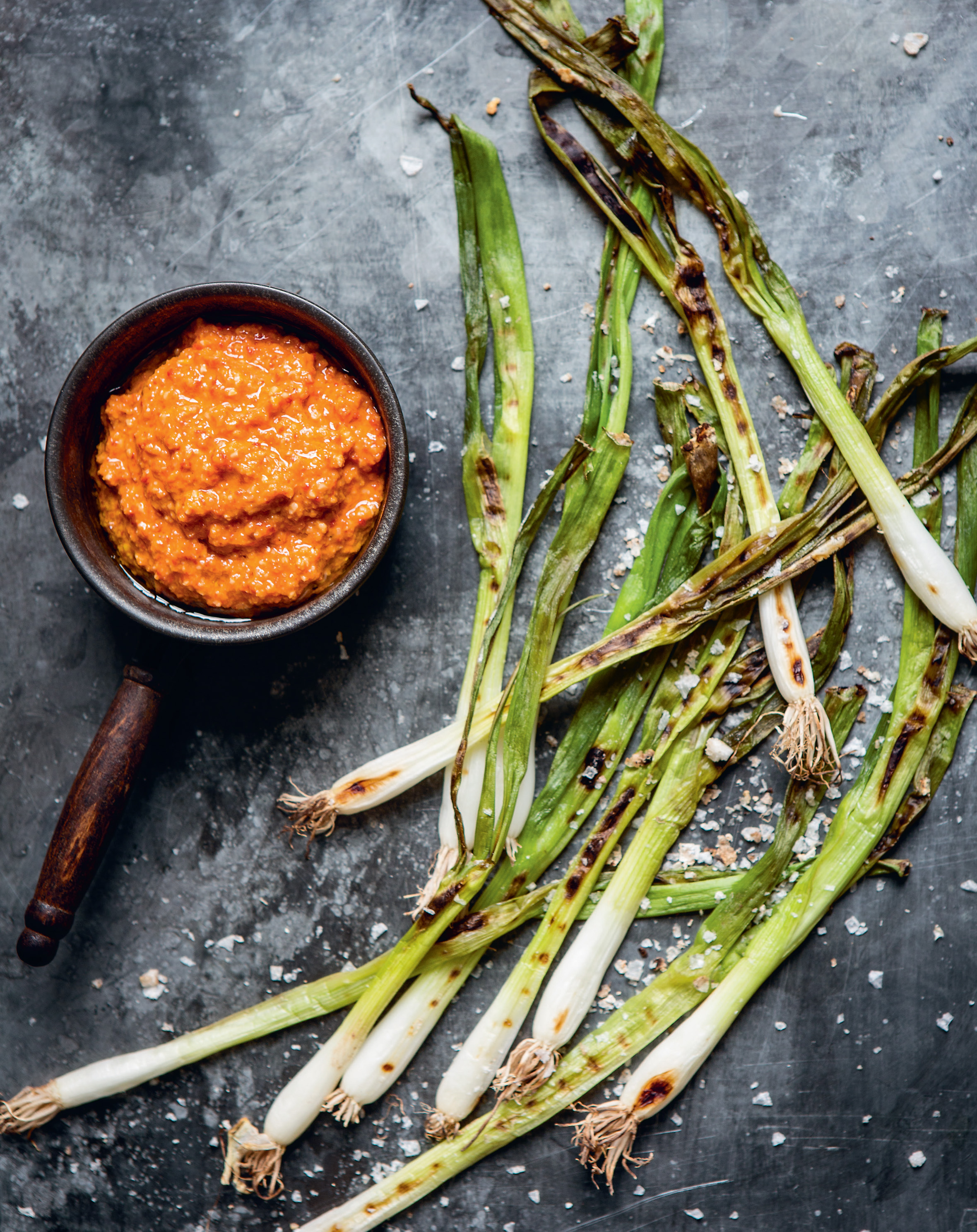 Romesco sauce with grilled spring onions