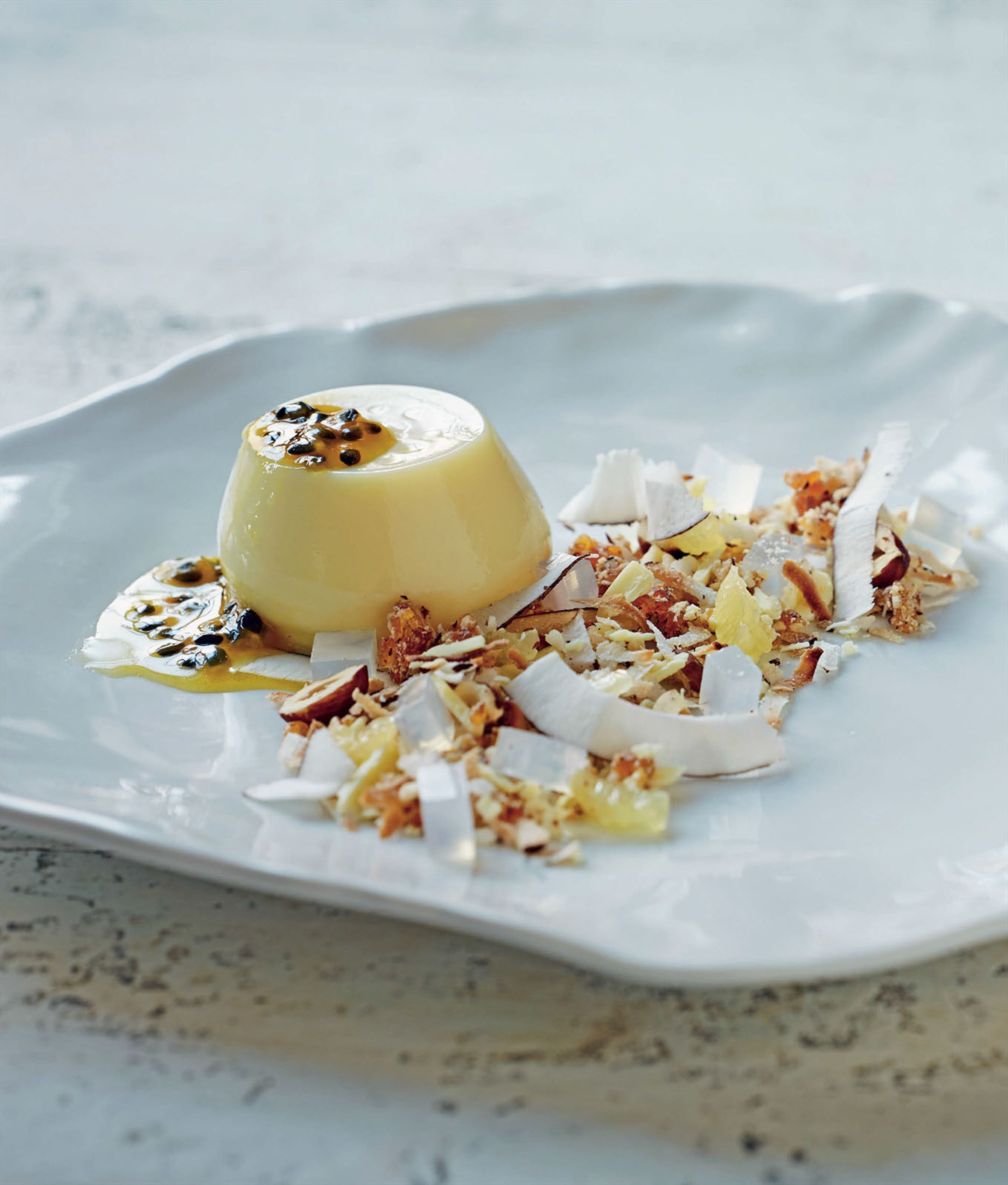 White chocolate panna cotta with coconut crumble and passionfruit syrup