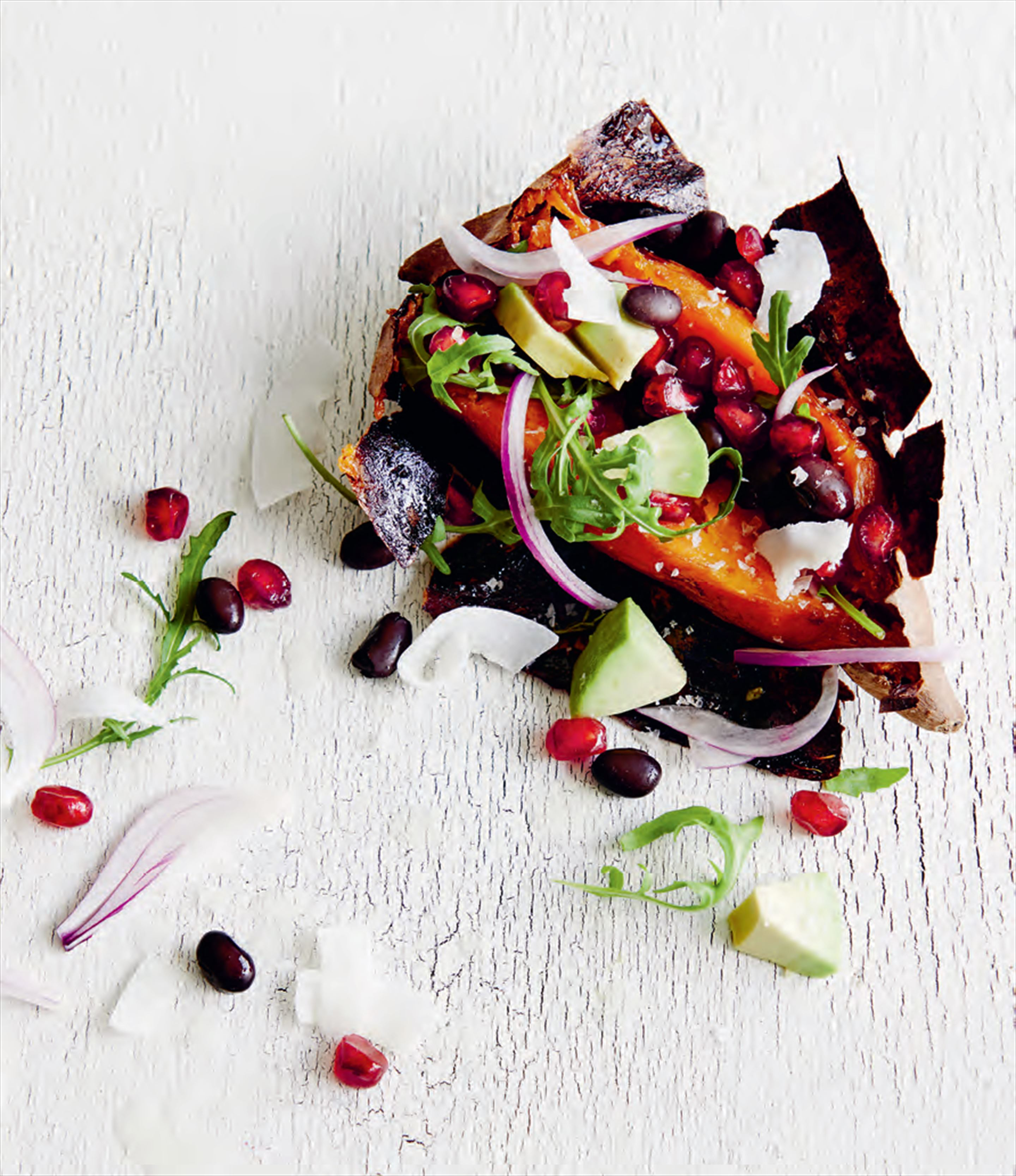 High-jacked sweet potato with avocado, pomegranate & coconut