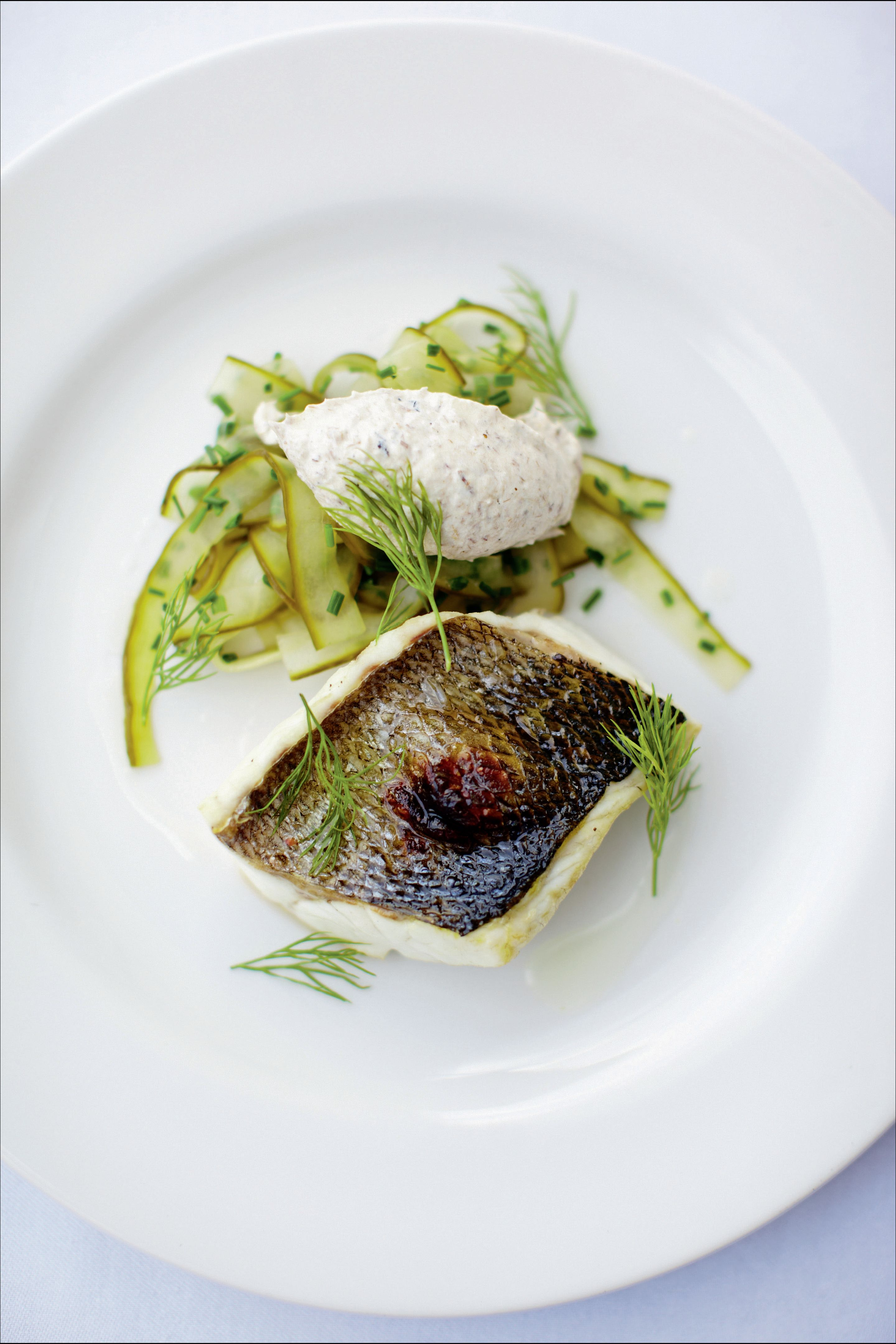 Grilled sea bass, smoked mackerel pâté and pickled cucumber