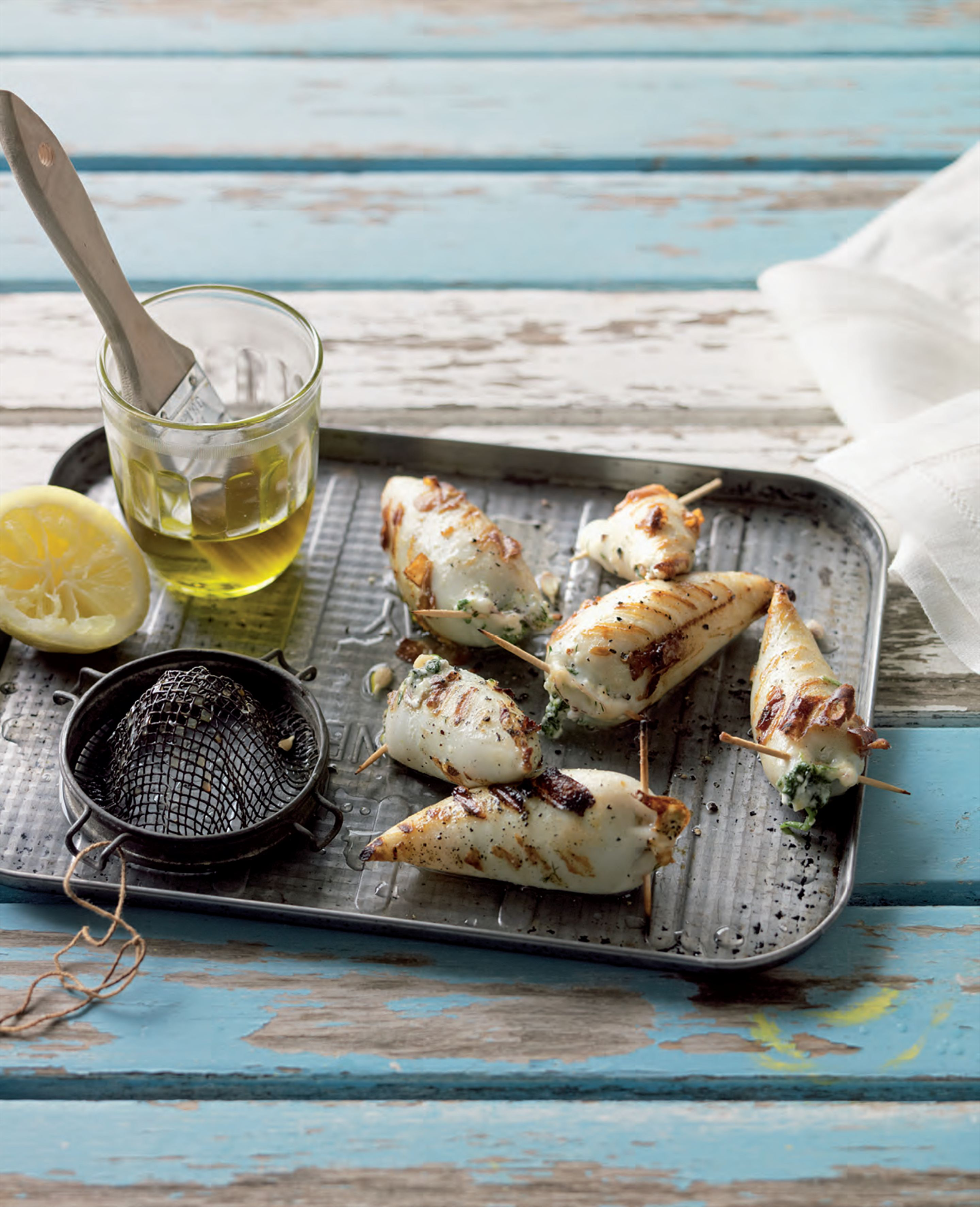 Barbecued squid filled with spinach and feta