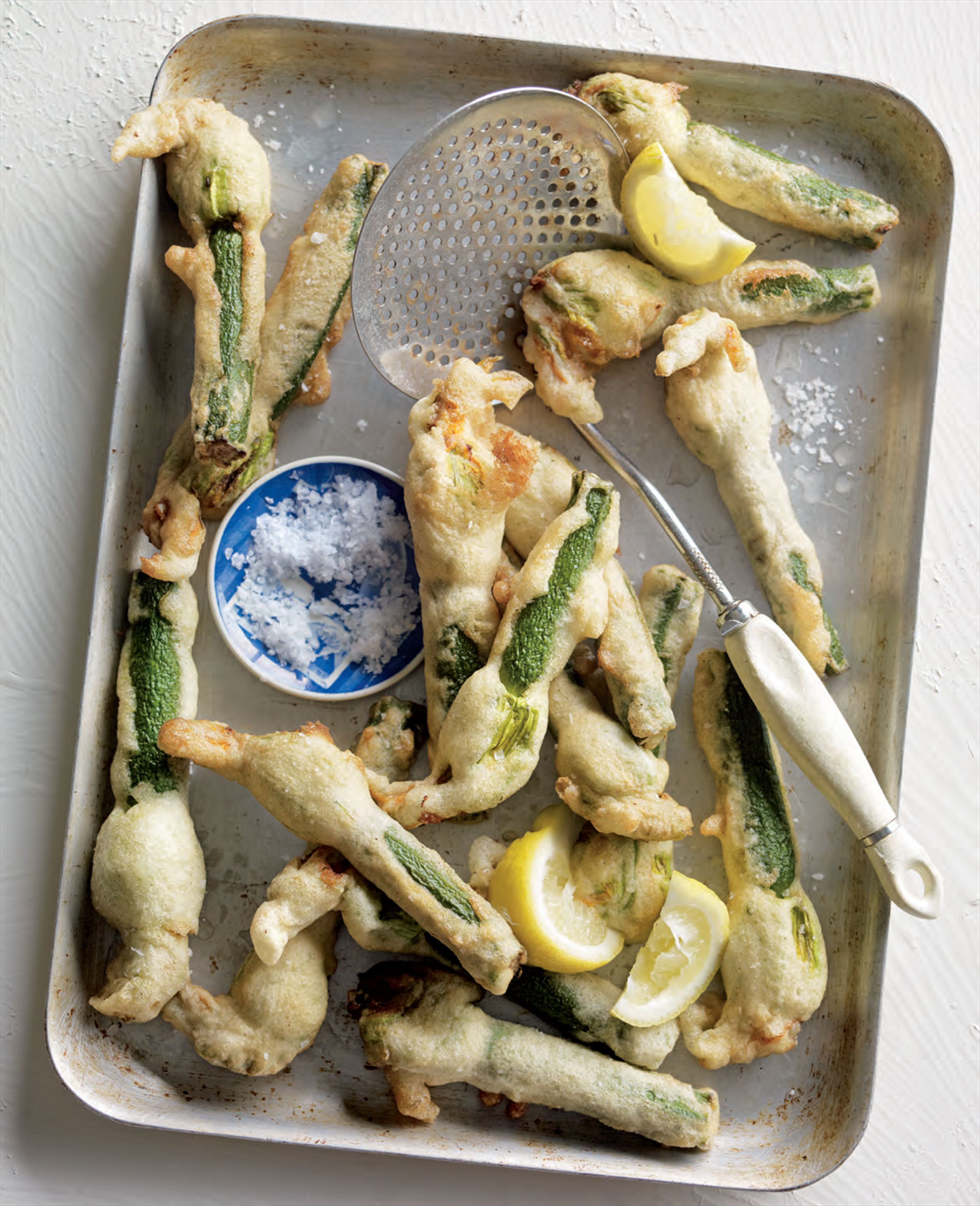 Ouzo-battered zucchini flowers stuffed with goat's curd