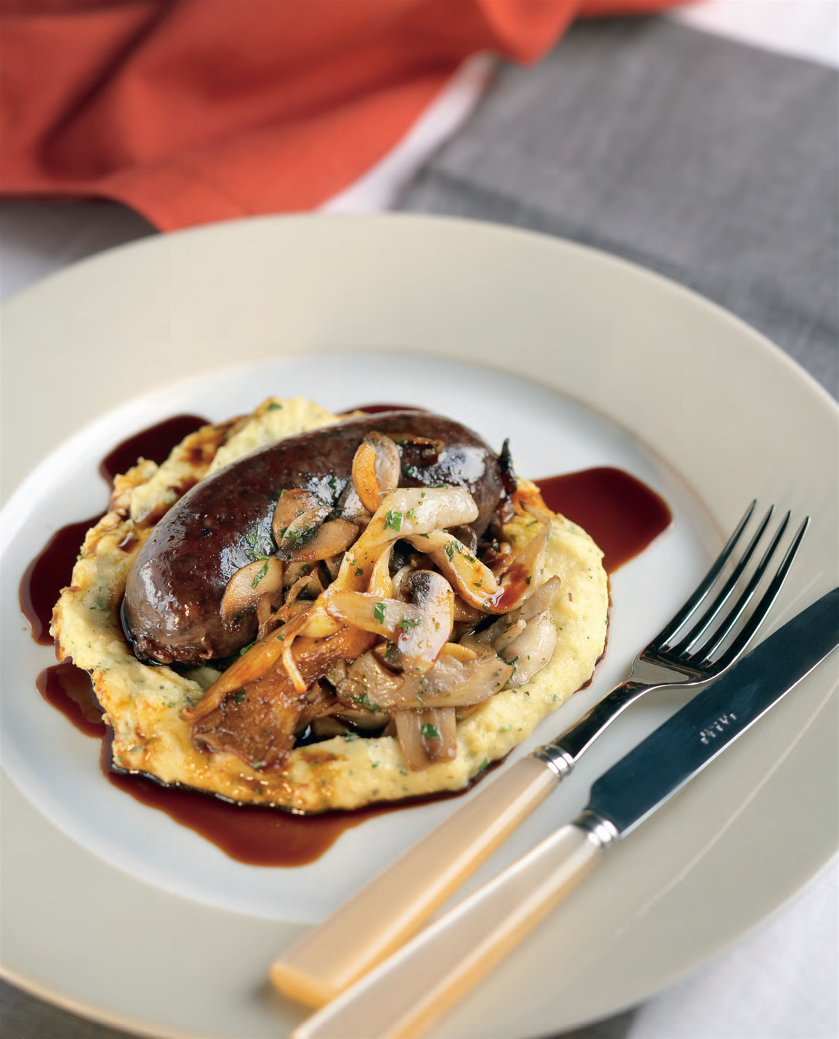 Blood sausage with roasted mushrooms, soft polenta and truffled pecorino