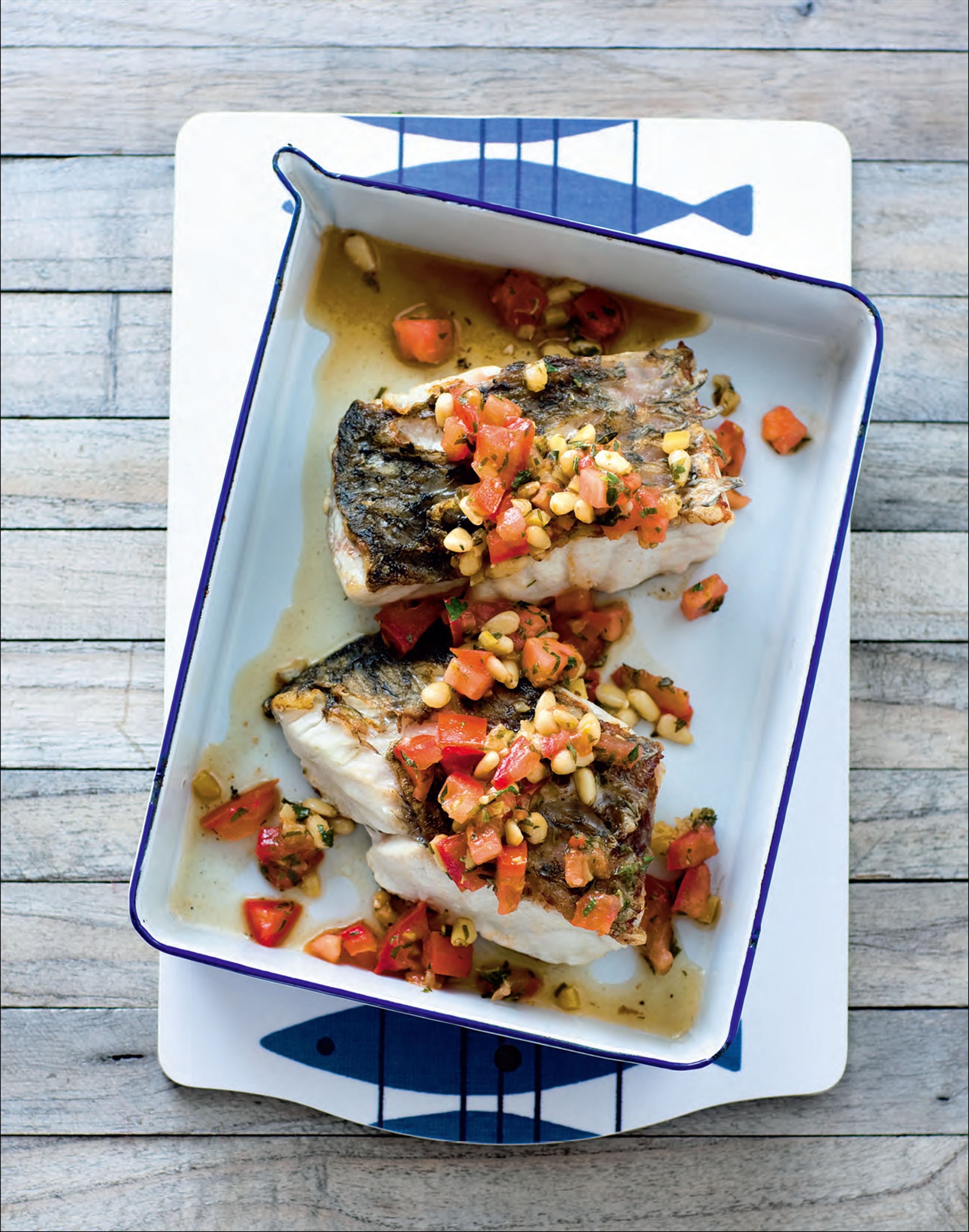 Barramundi with preserved lemon, tomato and pine nuts