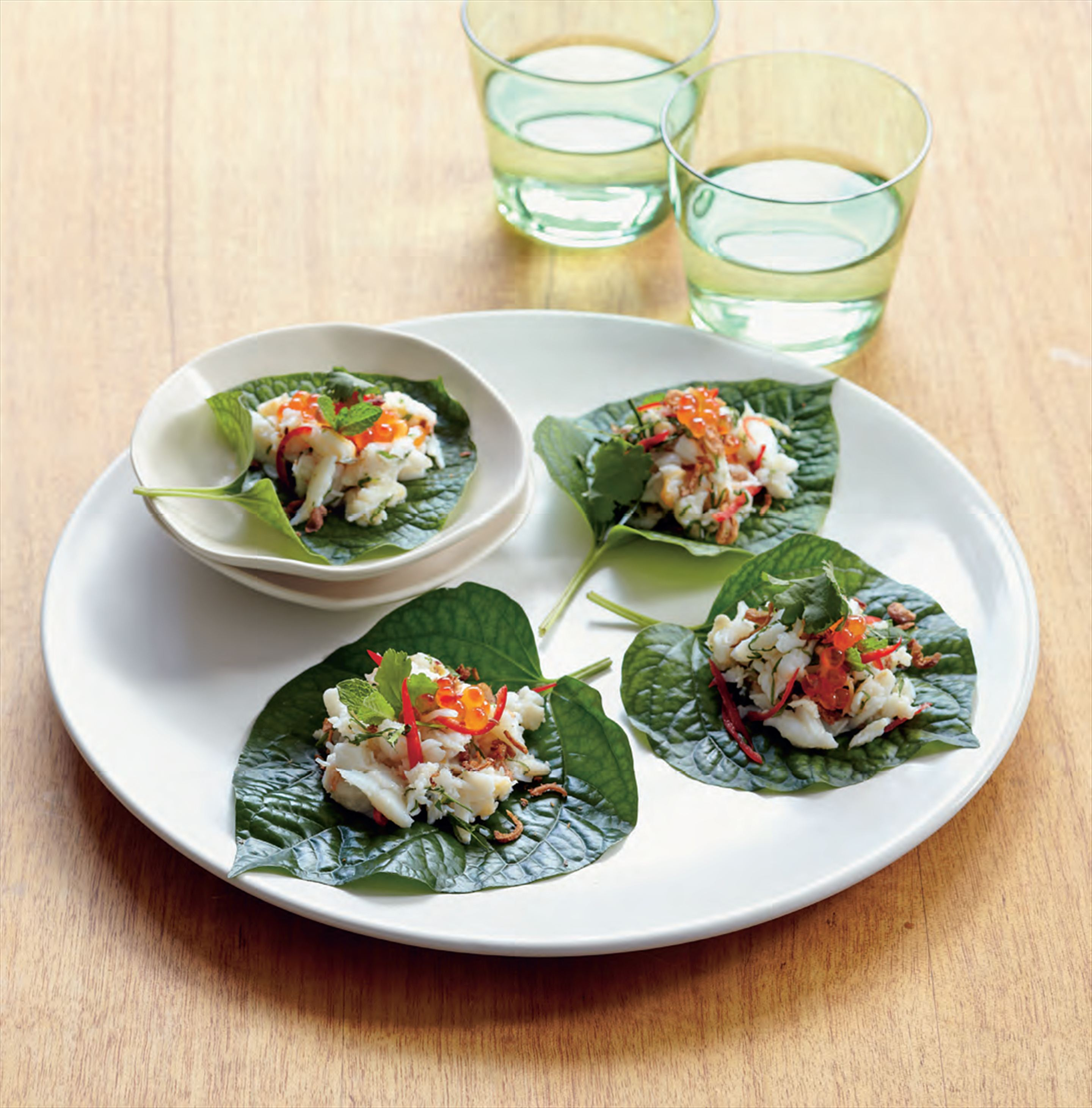 Betel leaves with crab, kaffir lime and chilli