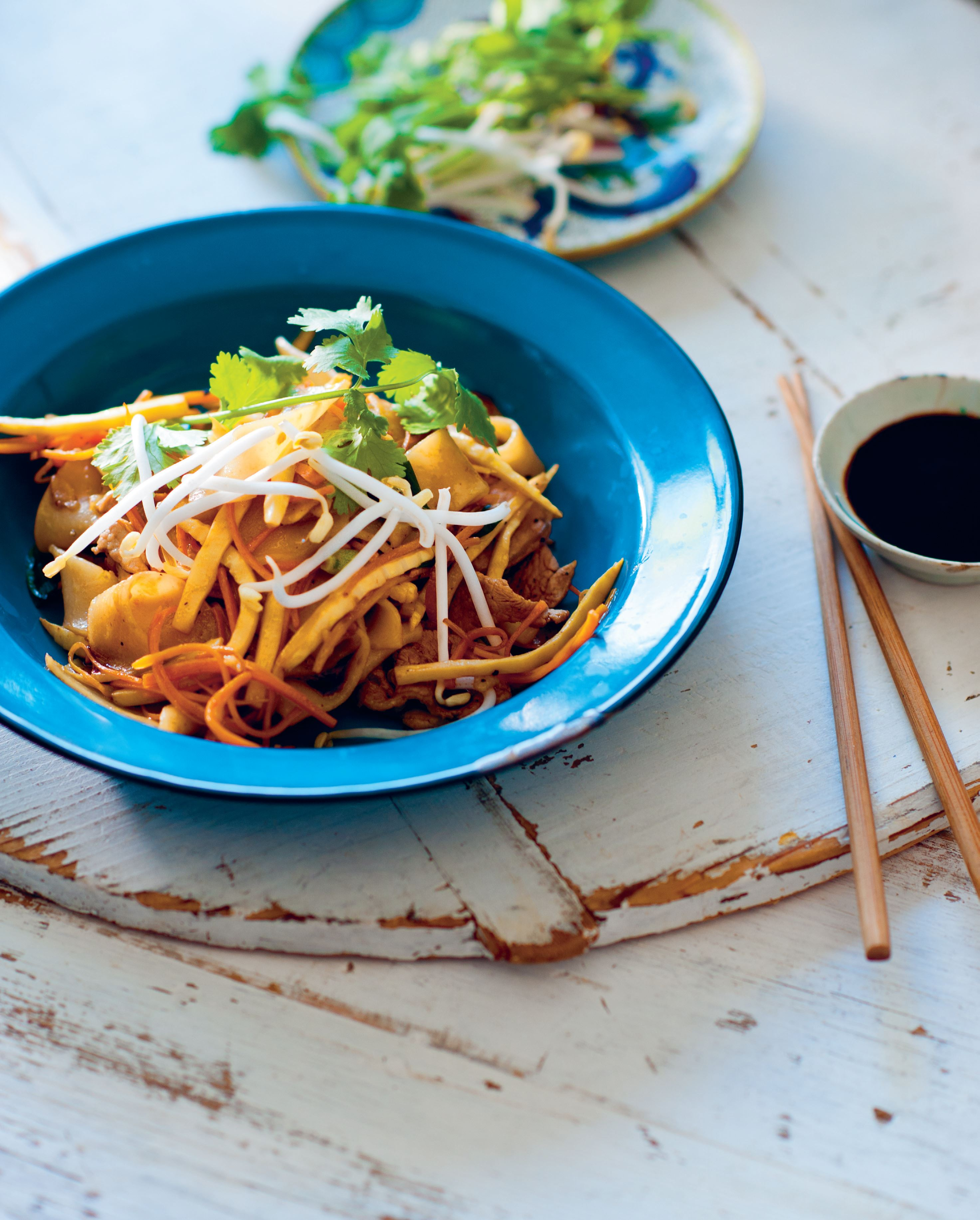 Rice noodles wok-tossed with bamboo and pork
