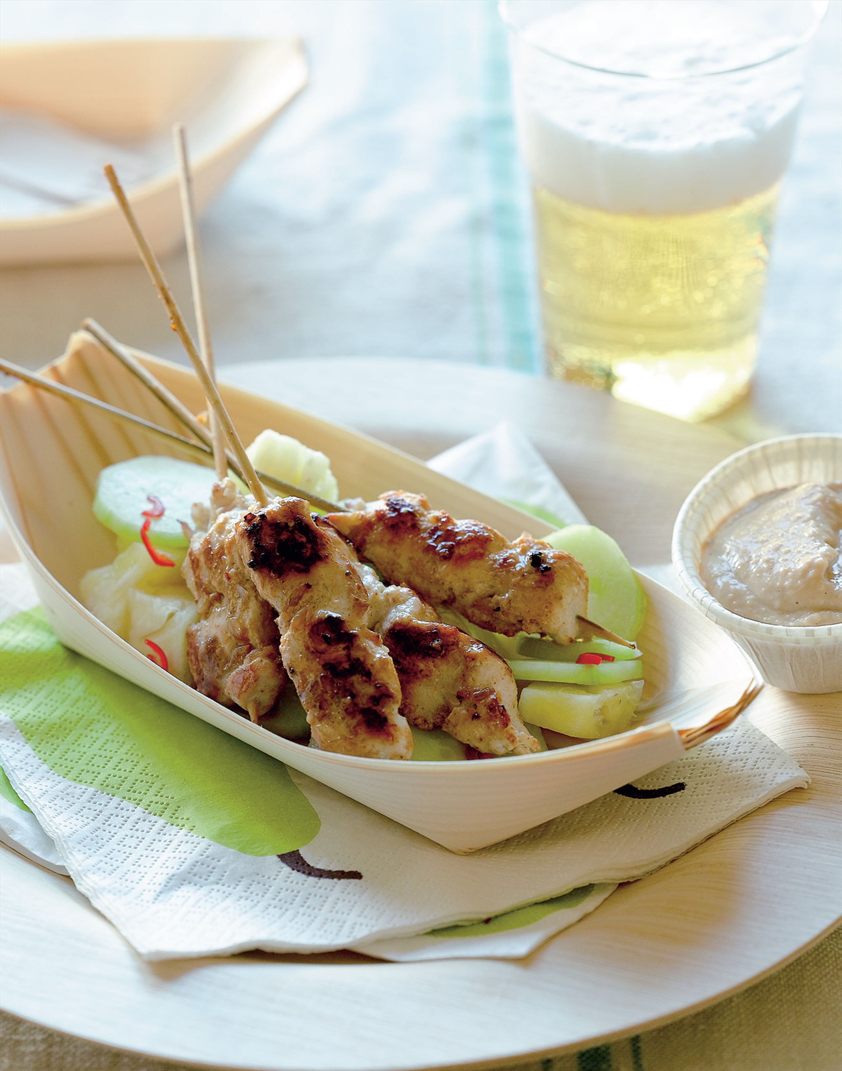 Satay chicken with peanut sauce, pineapple, and cucumber salad