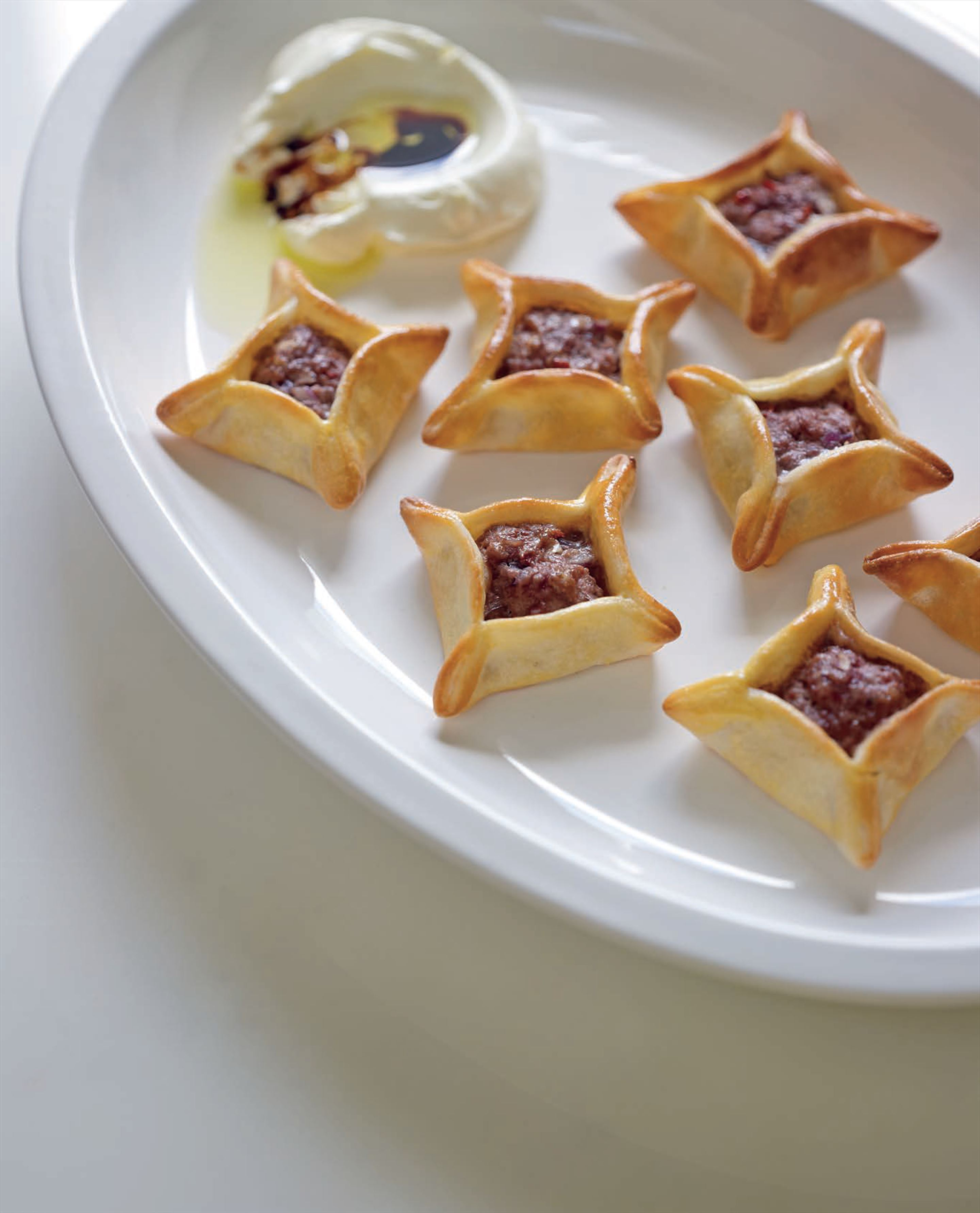 Little lamb pies with yoghurt cheese and pomegranate