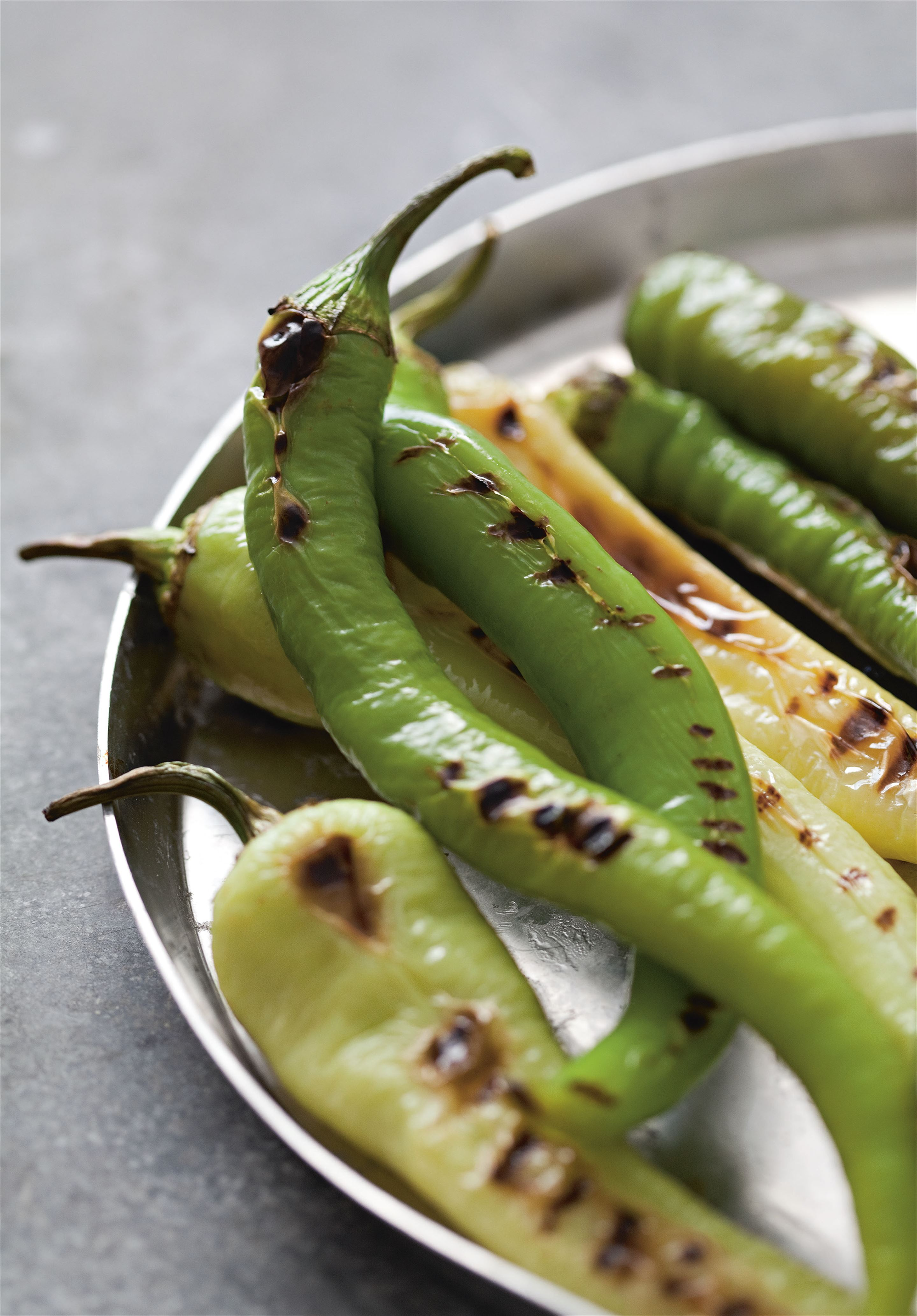 Grilled long green capsicums