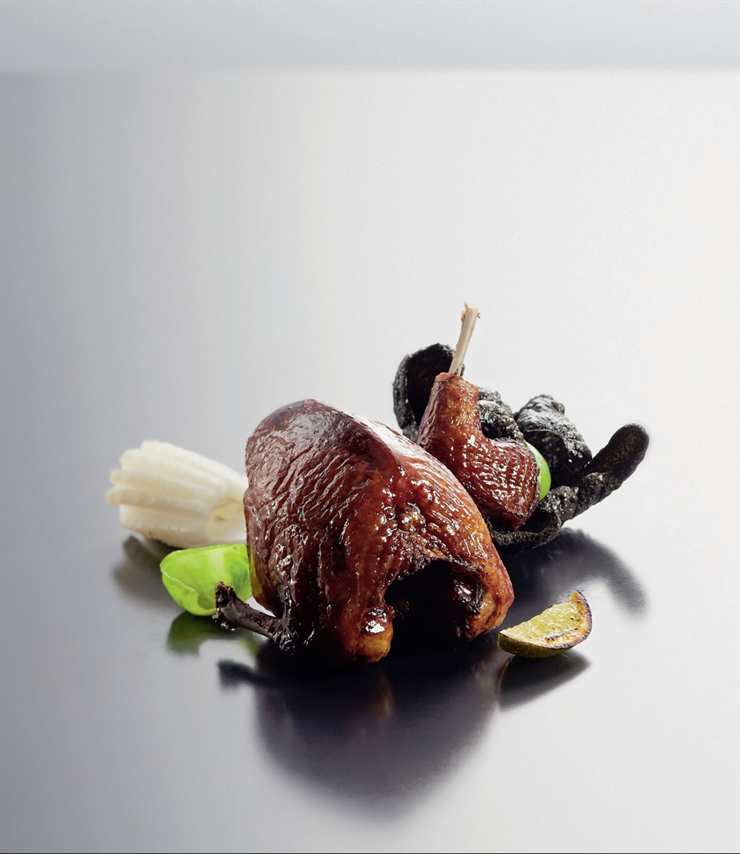 Squab and black rice with cuttlefish and lime