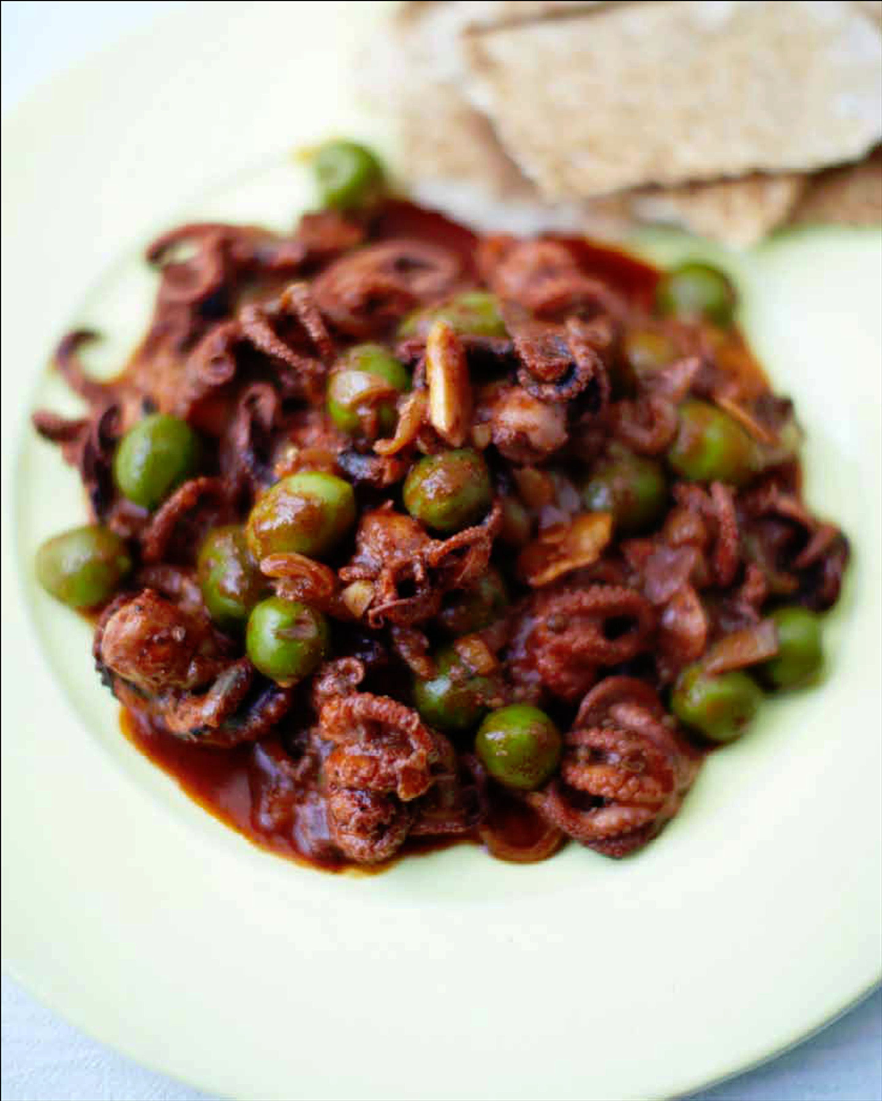 Baby octopus & green olive tagine