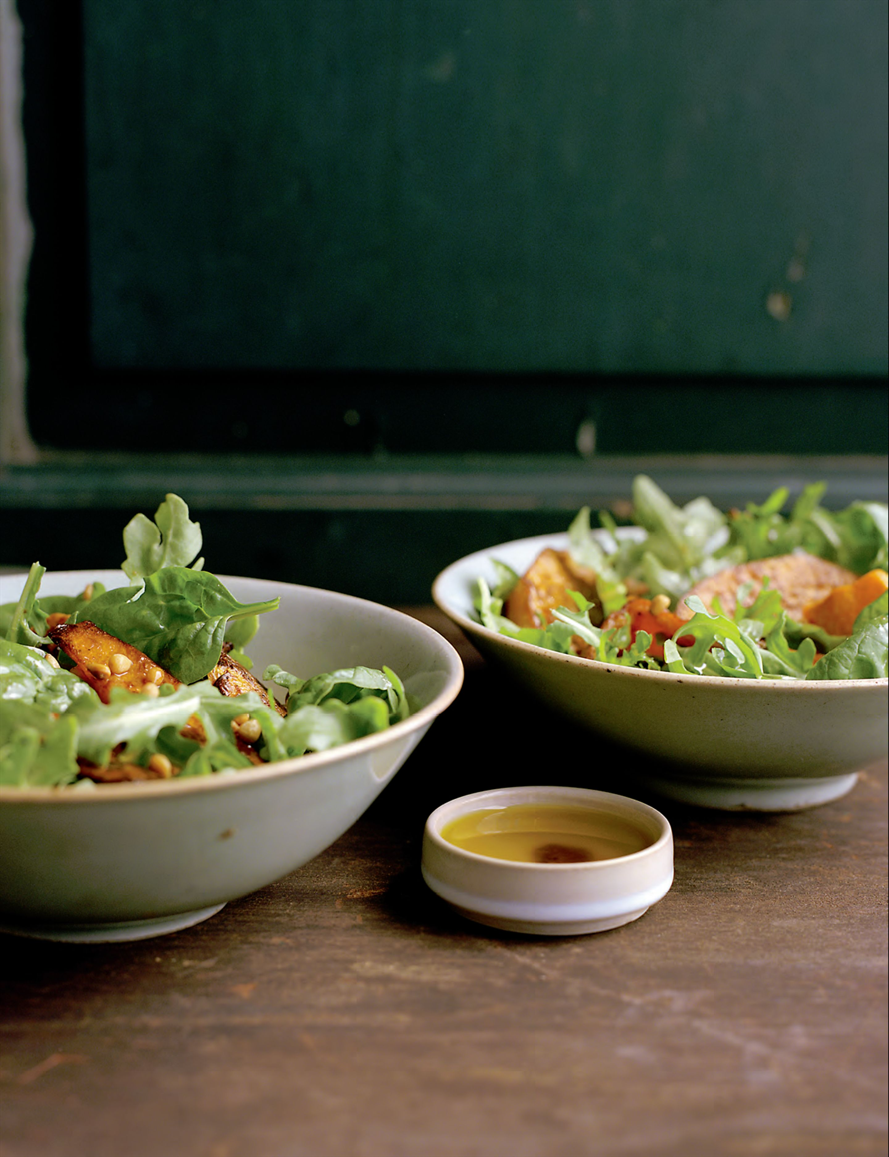 Mizuna salad with roasted pumpkin, pine nuts and ras-el-hanout dressing