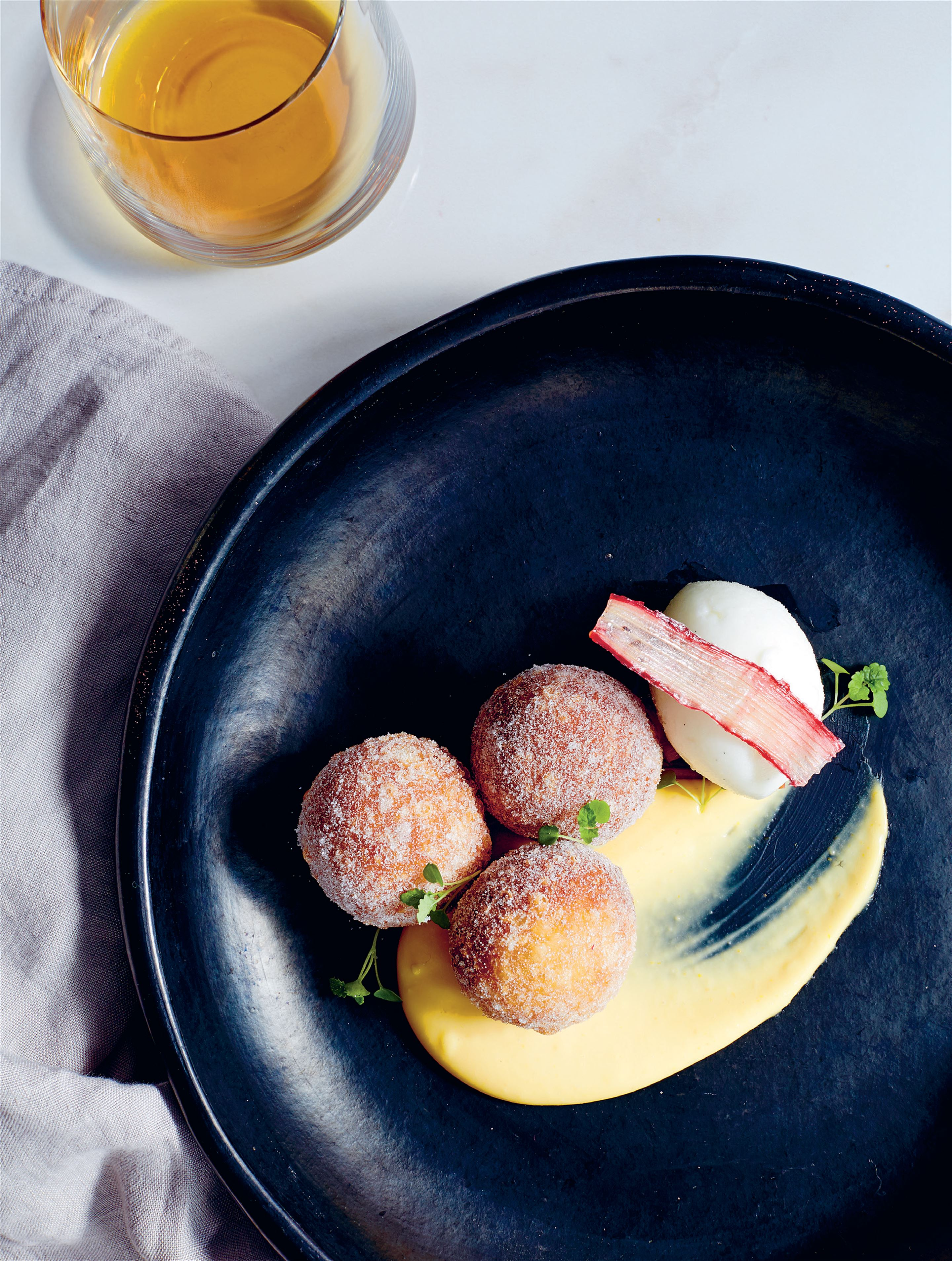 Rhubarb jam doughnuts with orange blossom custard & yoghurt sorbet