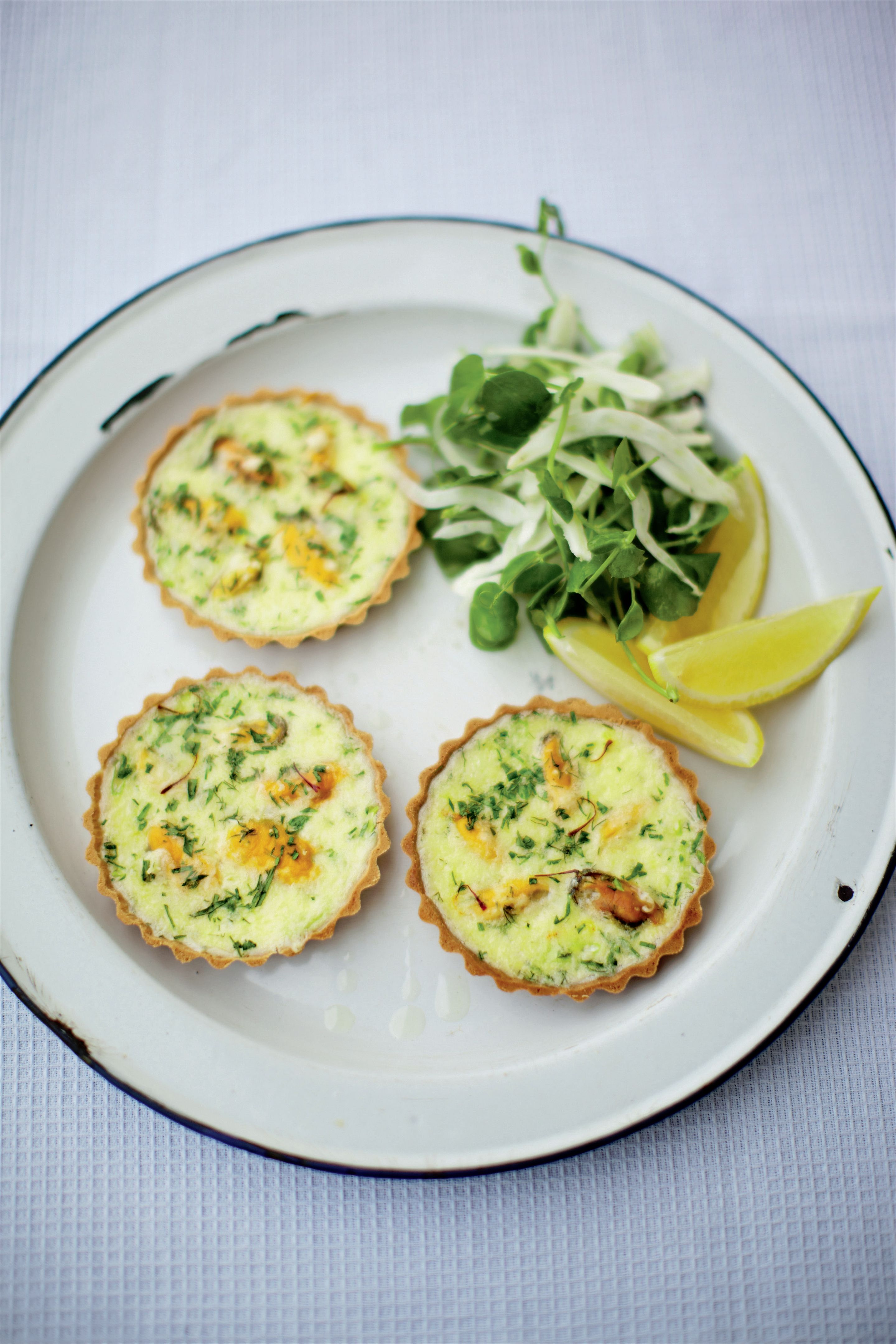 Mussel and saffron quiche with fennel and rocket salad