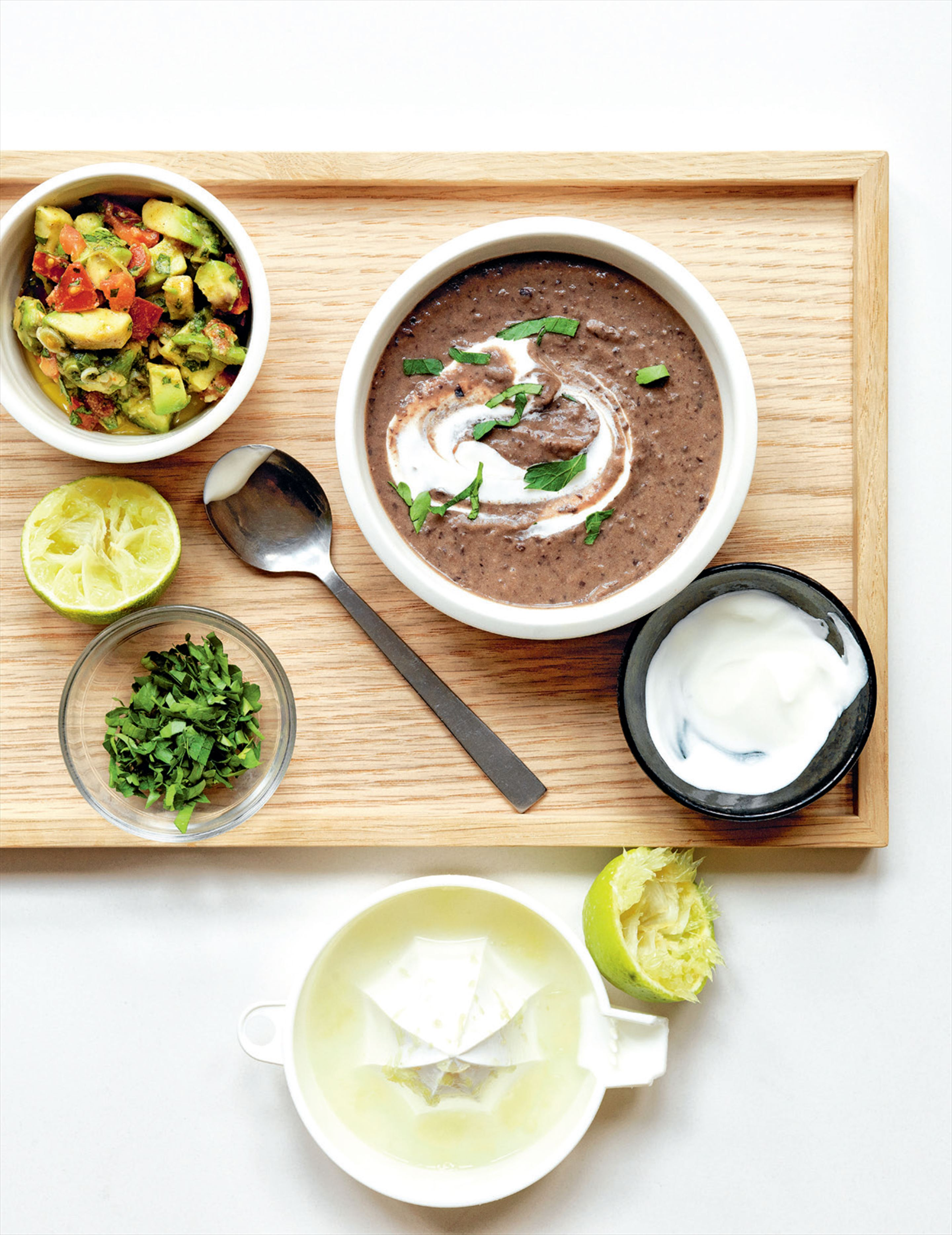Black bean soup with avocado salsa