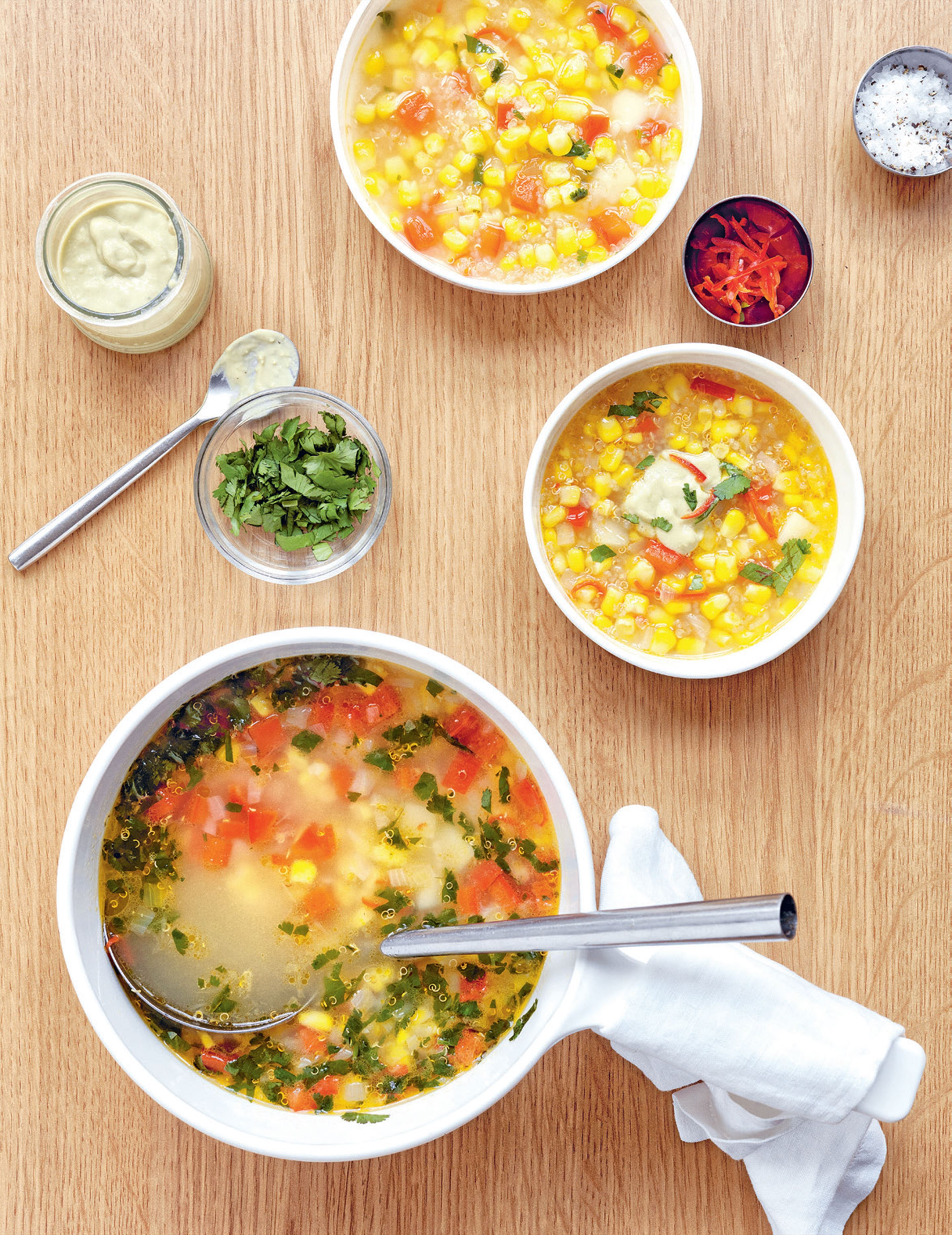 Corn, quinoa & capsicum soup with avocado cream