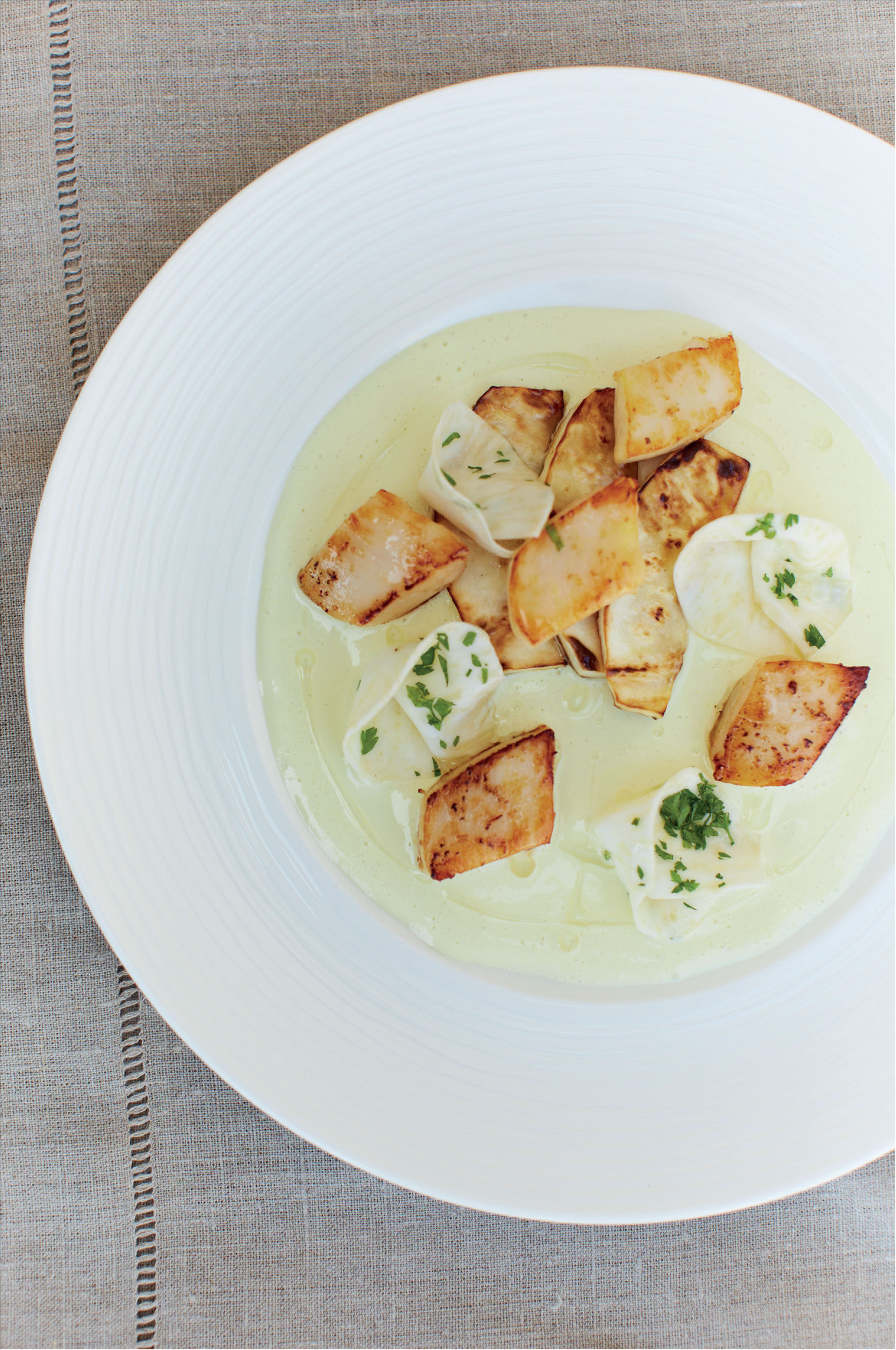 Scallops with celeriac and apple, cider and mustard sauce