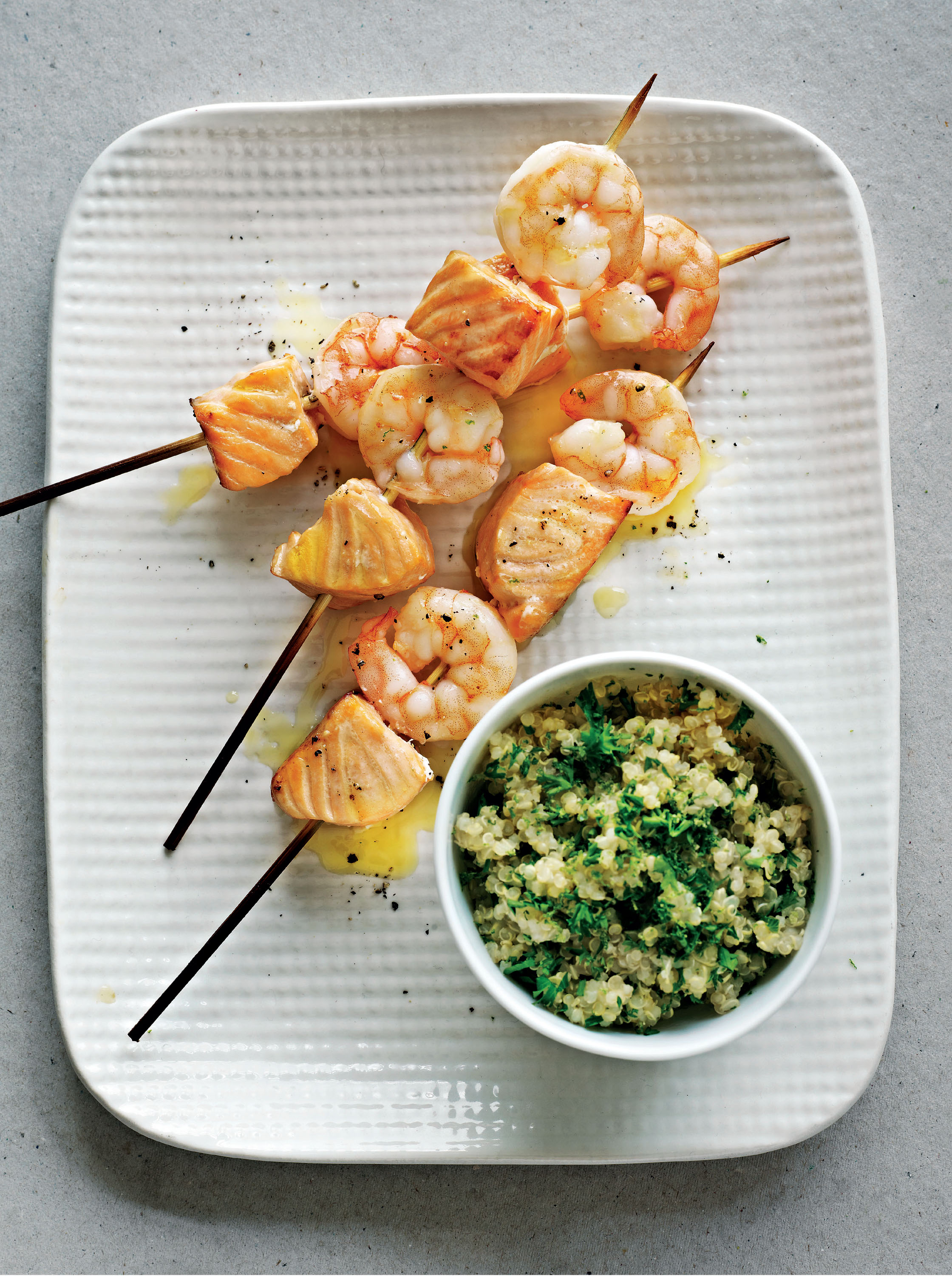 Salmon and king prawn skewers with citrus quinoa salad