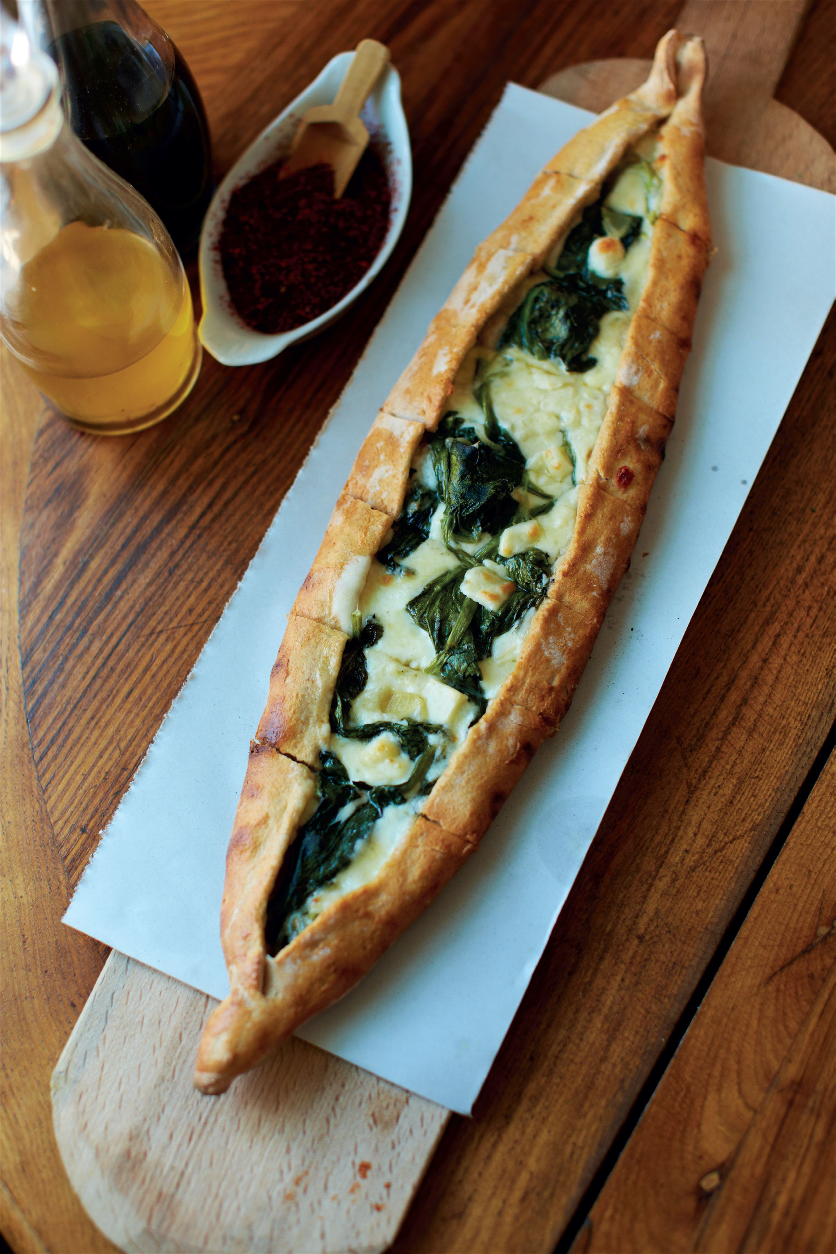 Cheese pide, and spinach and cheese pide