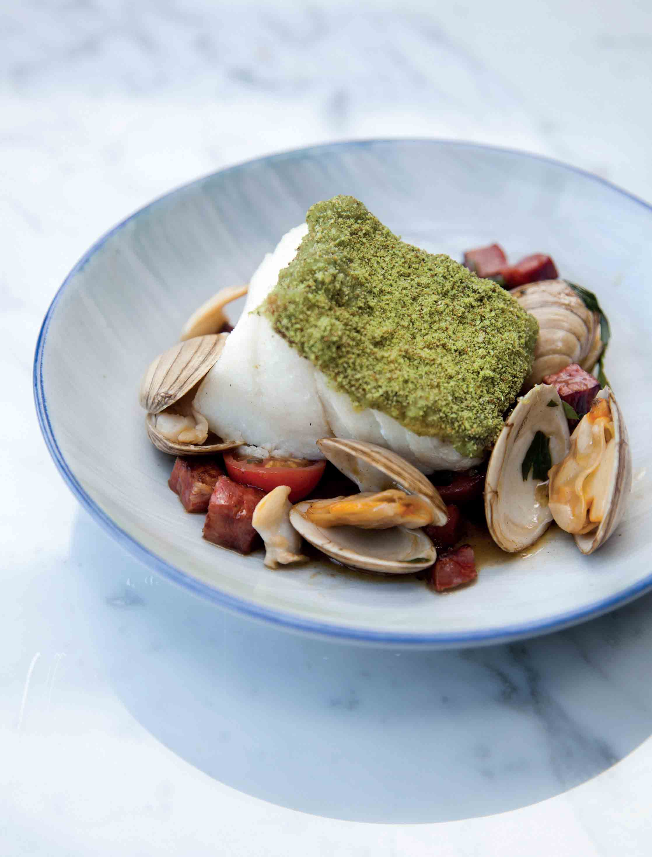 Fillet of cod with herb breadcrumbs, chorizo and clams