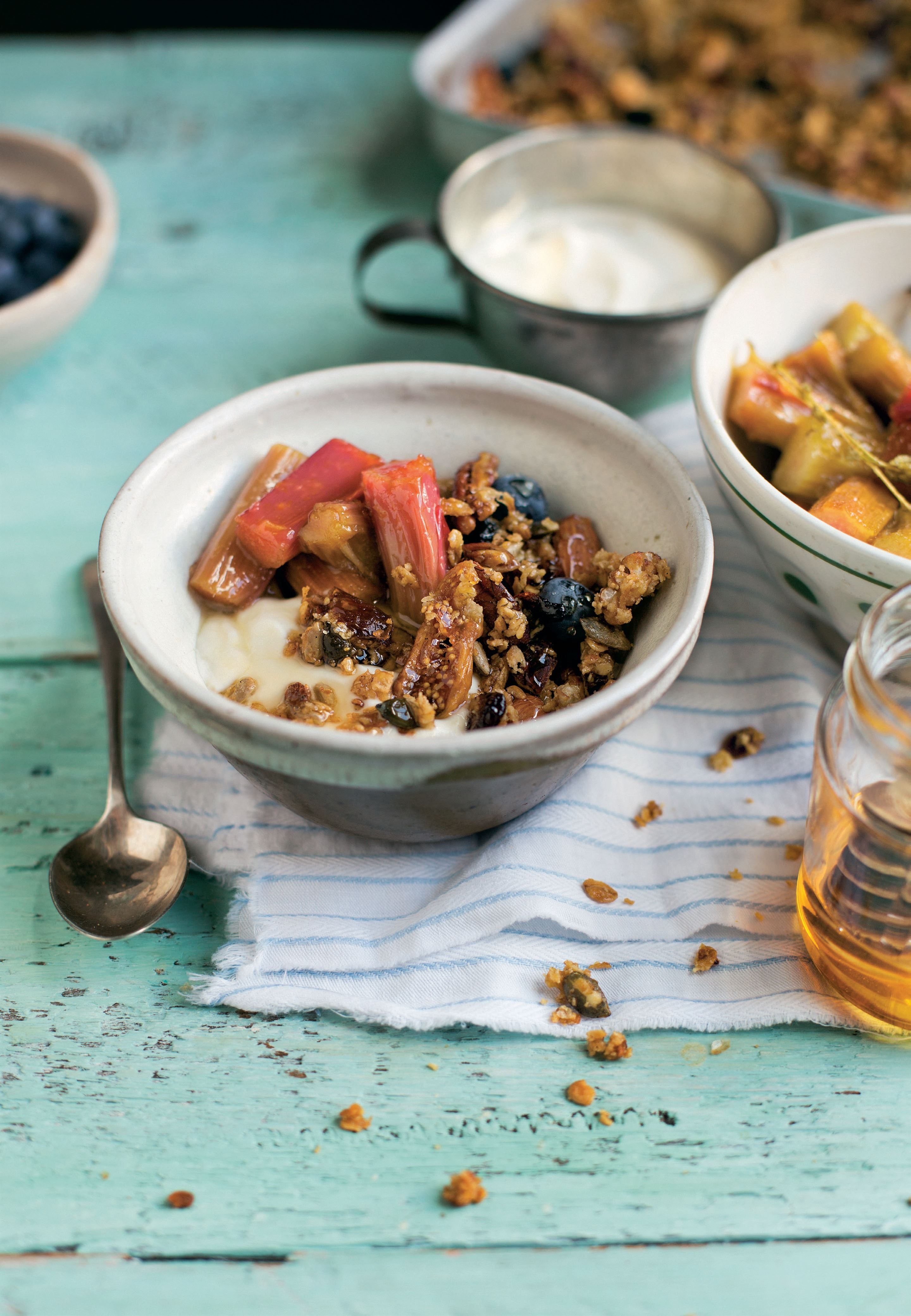 Rhubarb compote with granola, blueberries, yogurt and honey