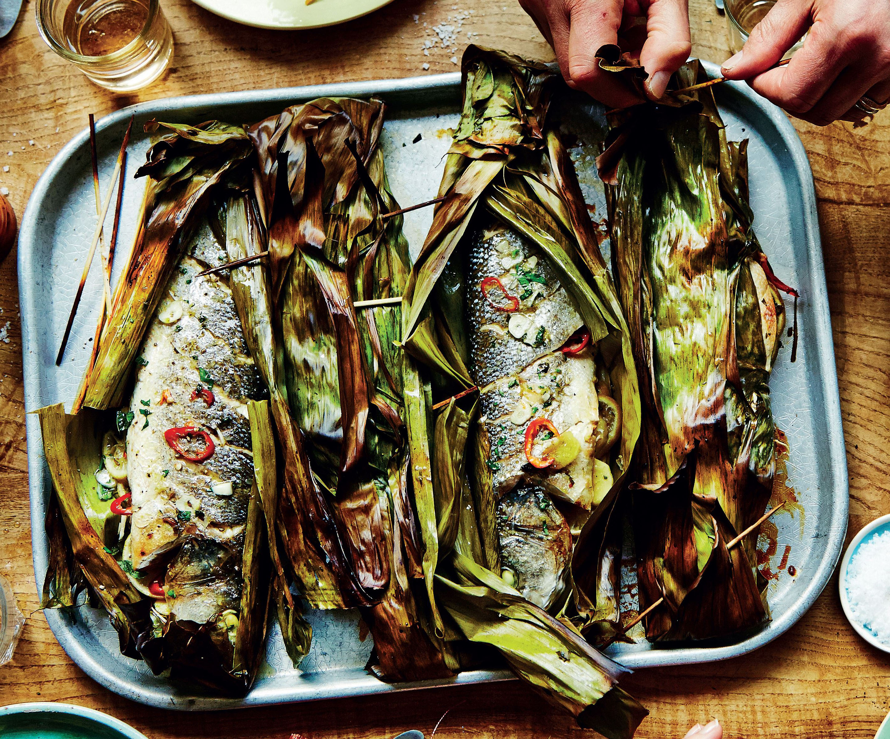 Grilled sea bass in banana leaves