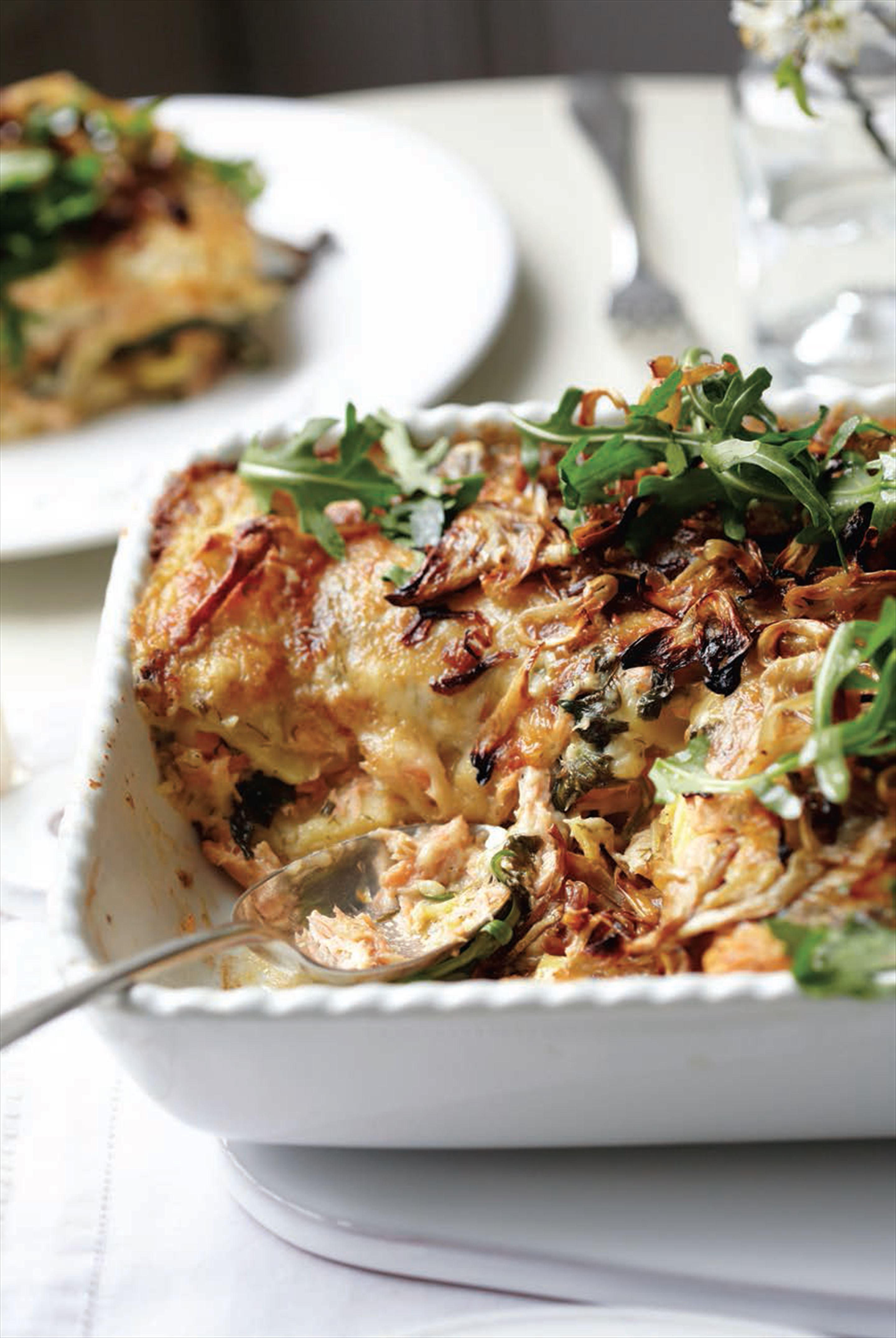 Salmon lasagne with caramelised fennel and rocket salad