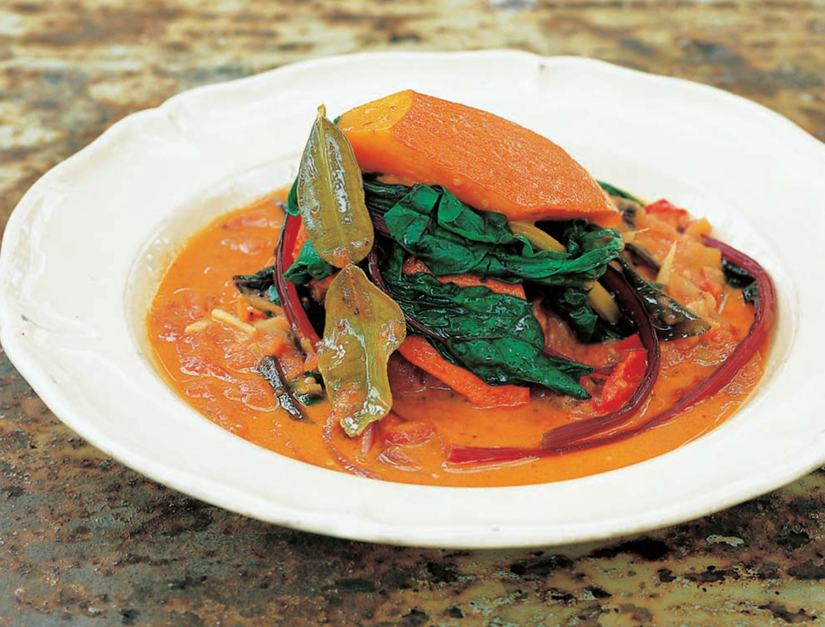 Squash and tomato curry with lime and coconut