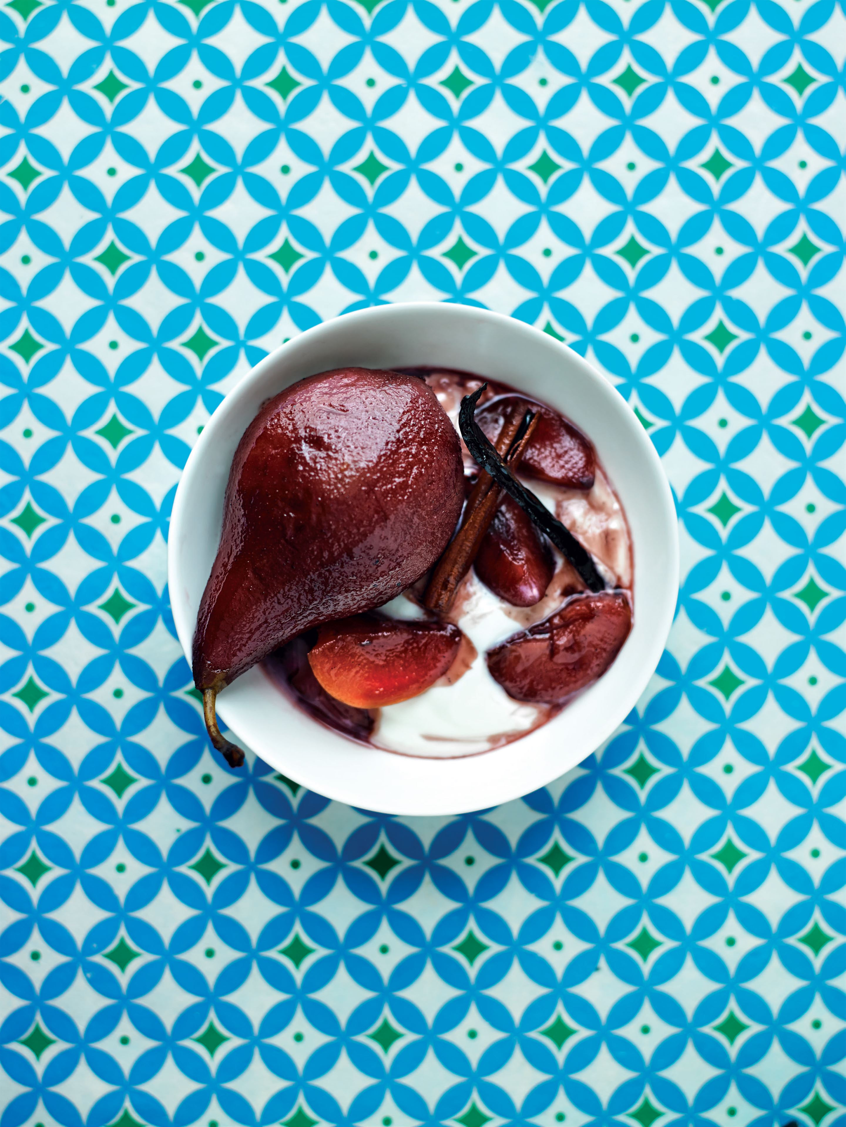 Spiced pears and plums in red wine syrup
