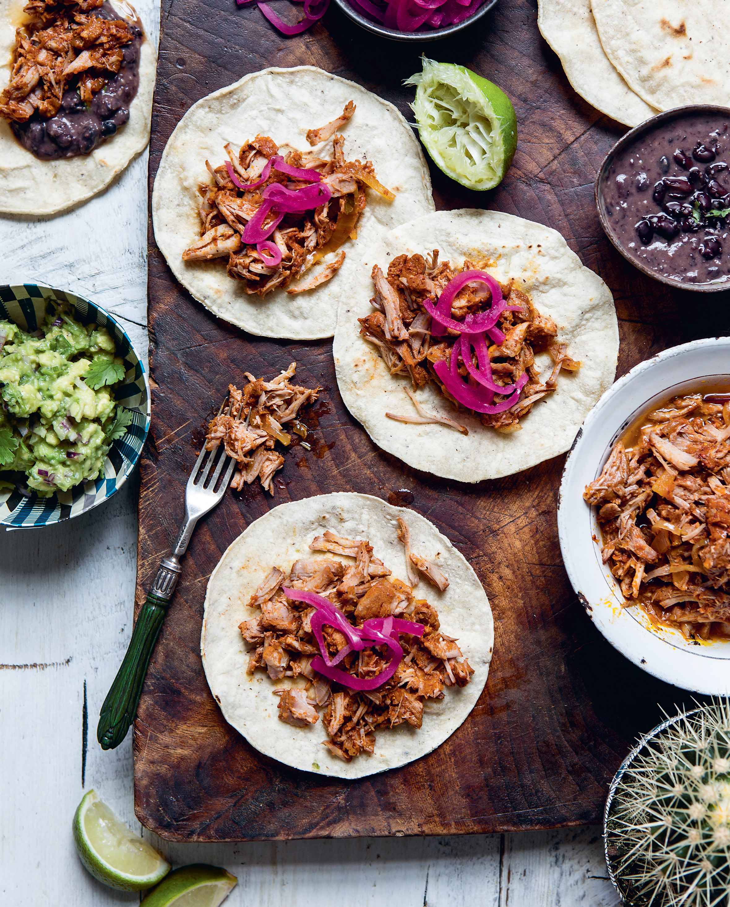 Melting Mexican pork tacos with pink pickled onions