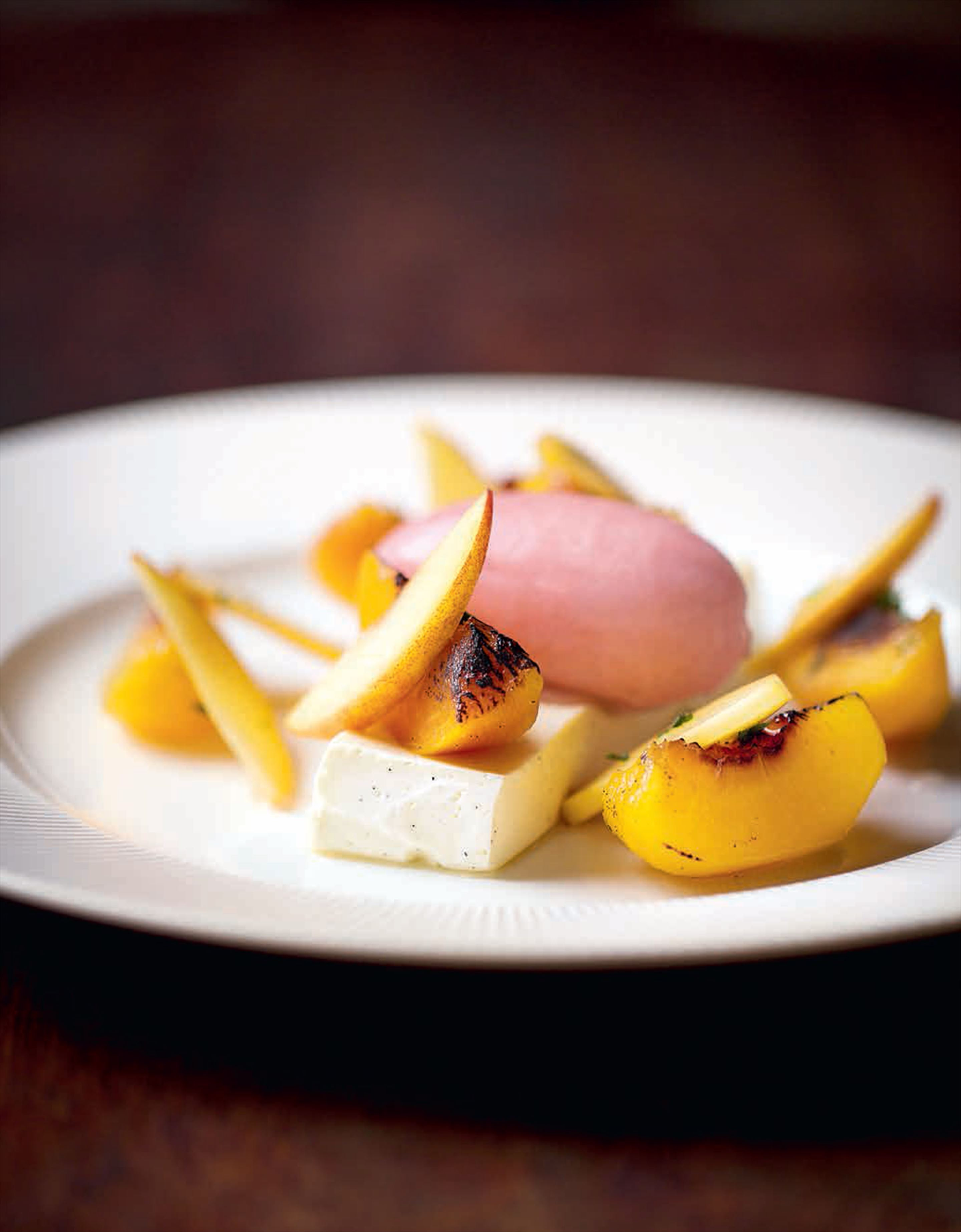 Champagne-poached peaches with vanilla yoghurt terrine