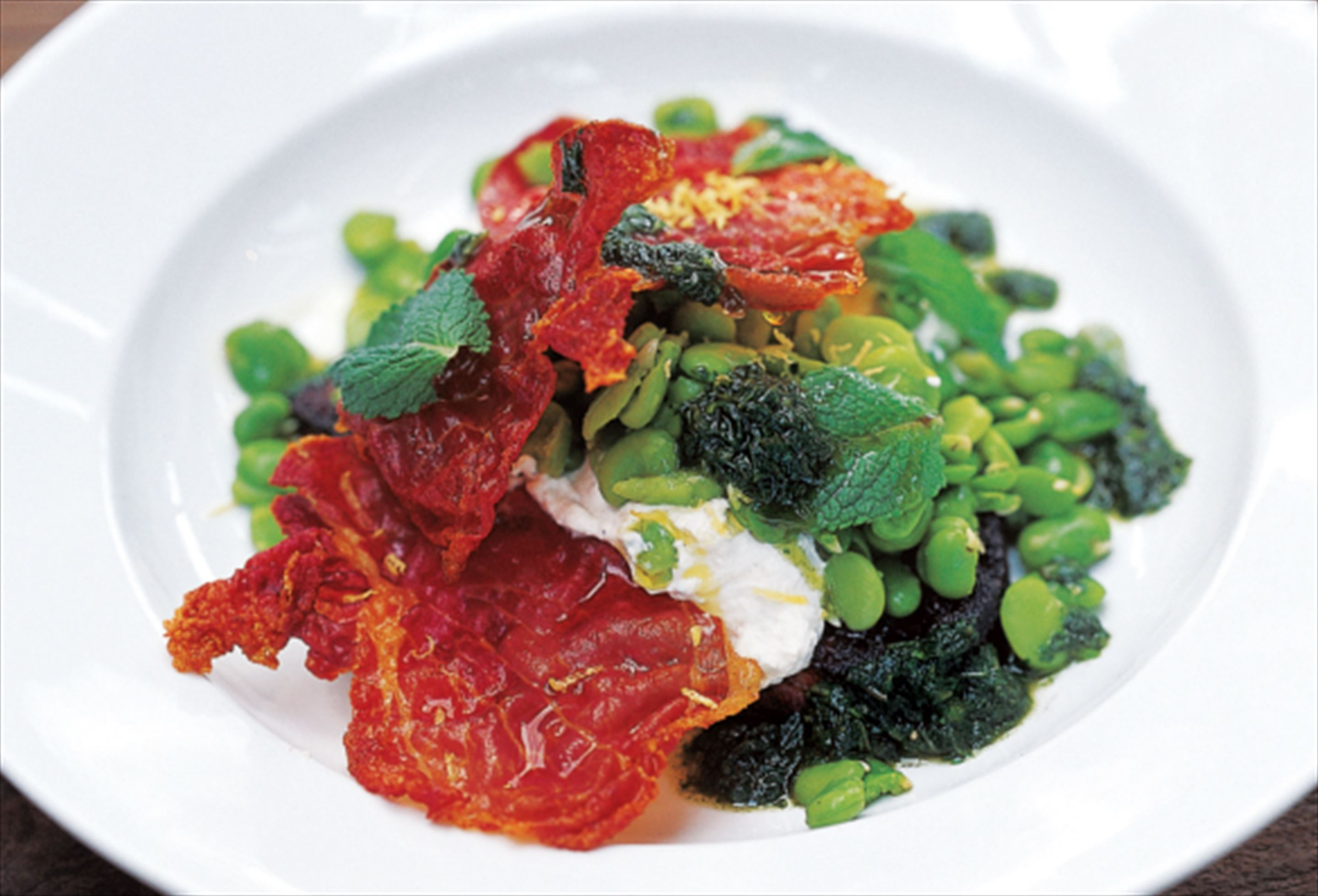Broad beans with mint, ricotta and crisp parma ham