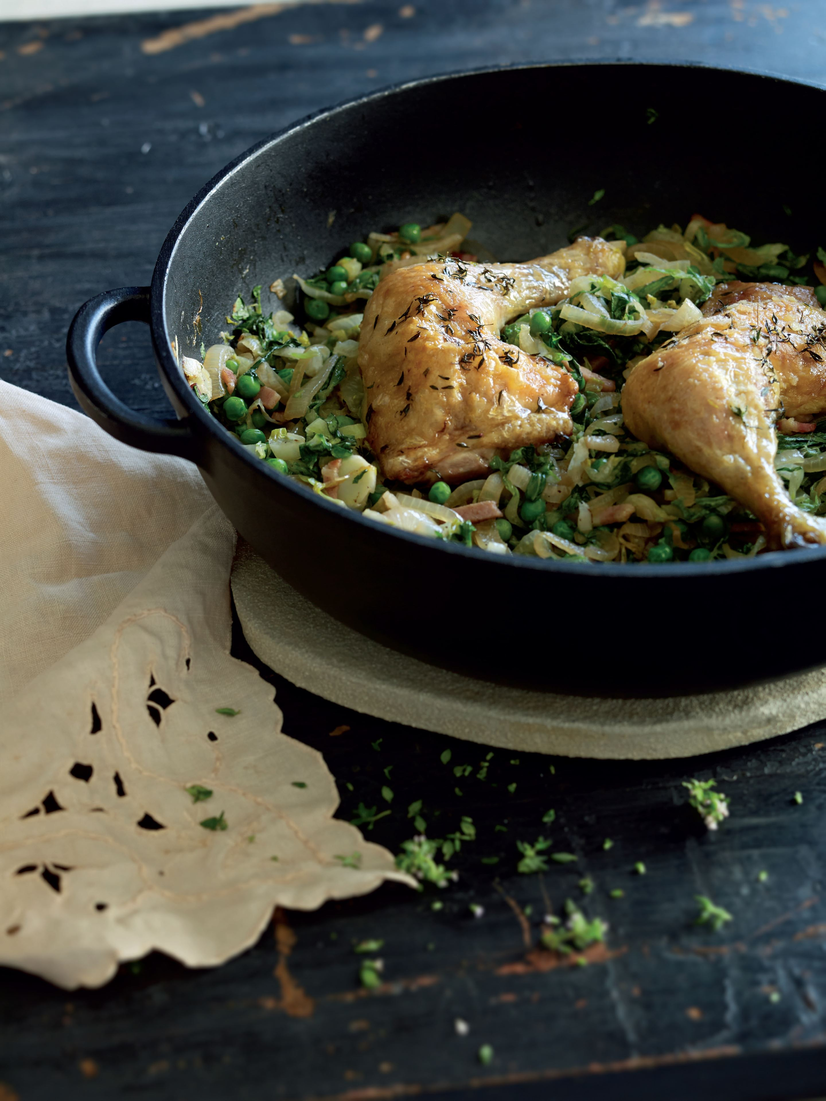 Thyme-roasted chicken legs with braised baby lettuce and peas