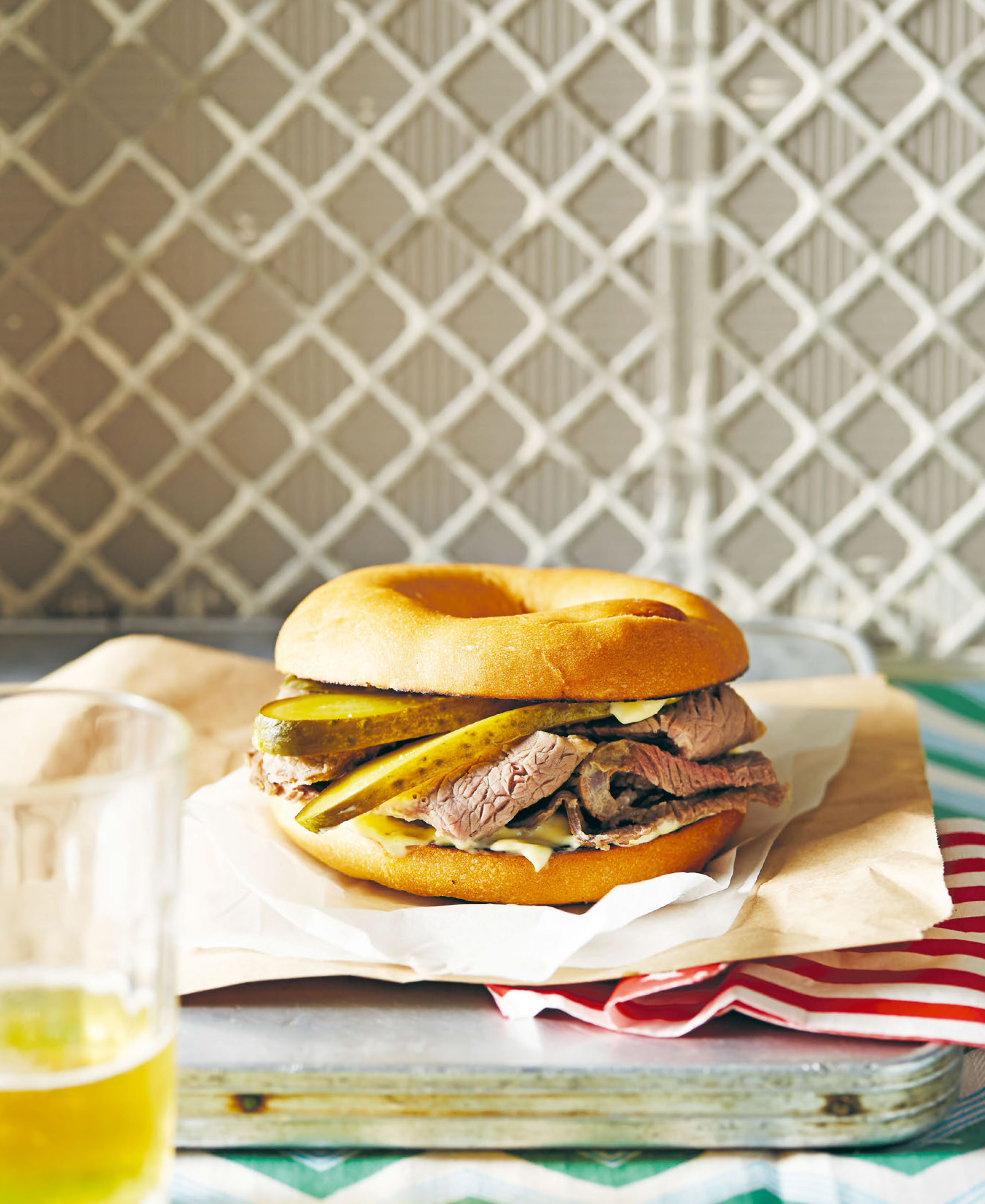 Salt beef bagel with hot English mustard and pickles