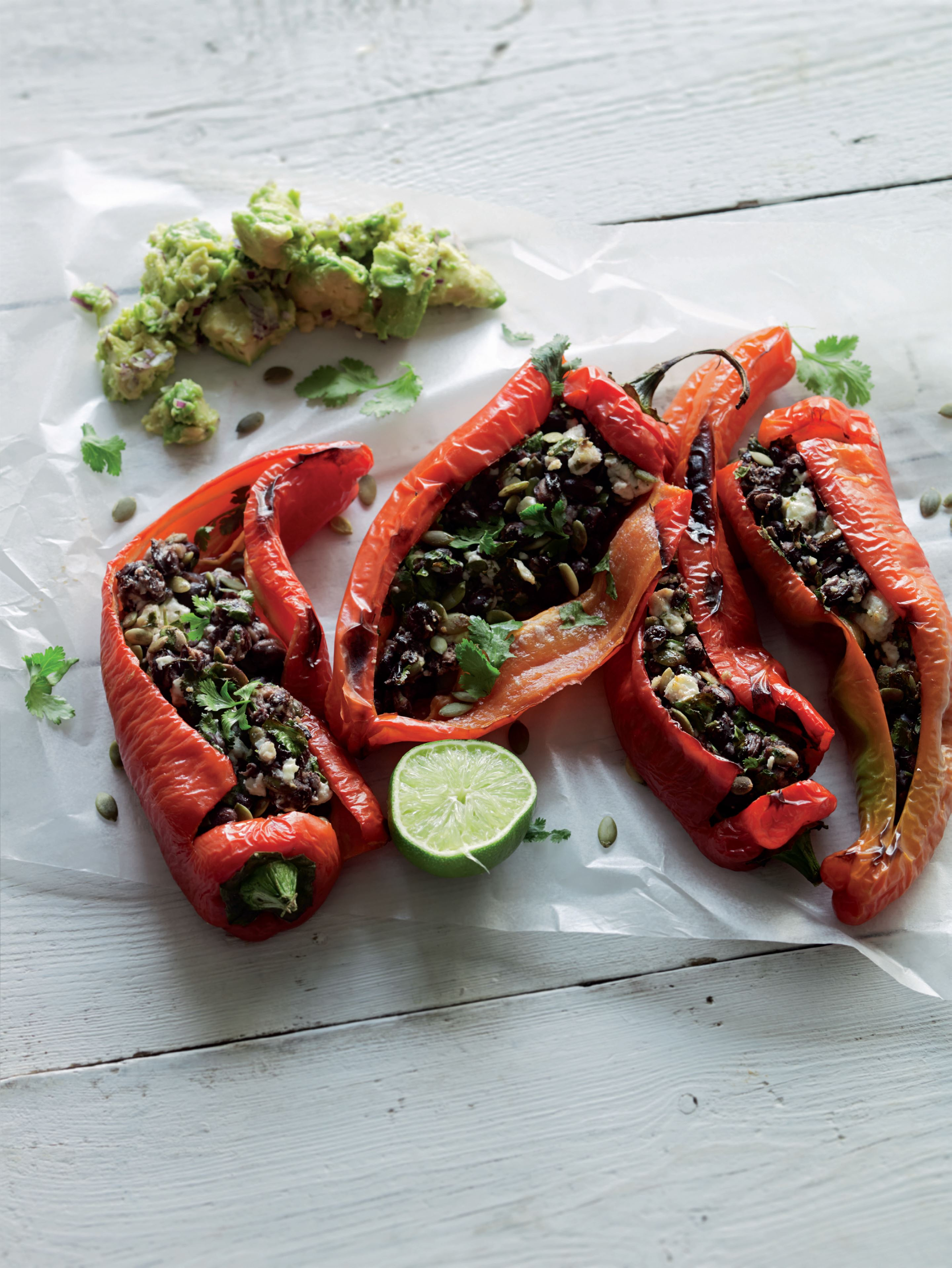 Griddled chillies stuffed with feta, black beans and pumpkin seeds