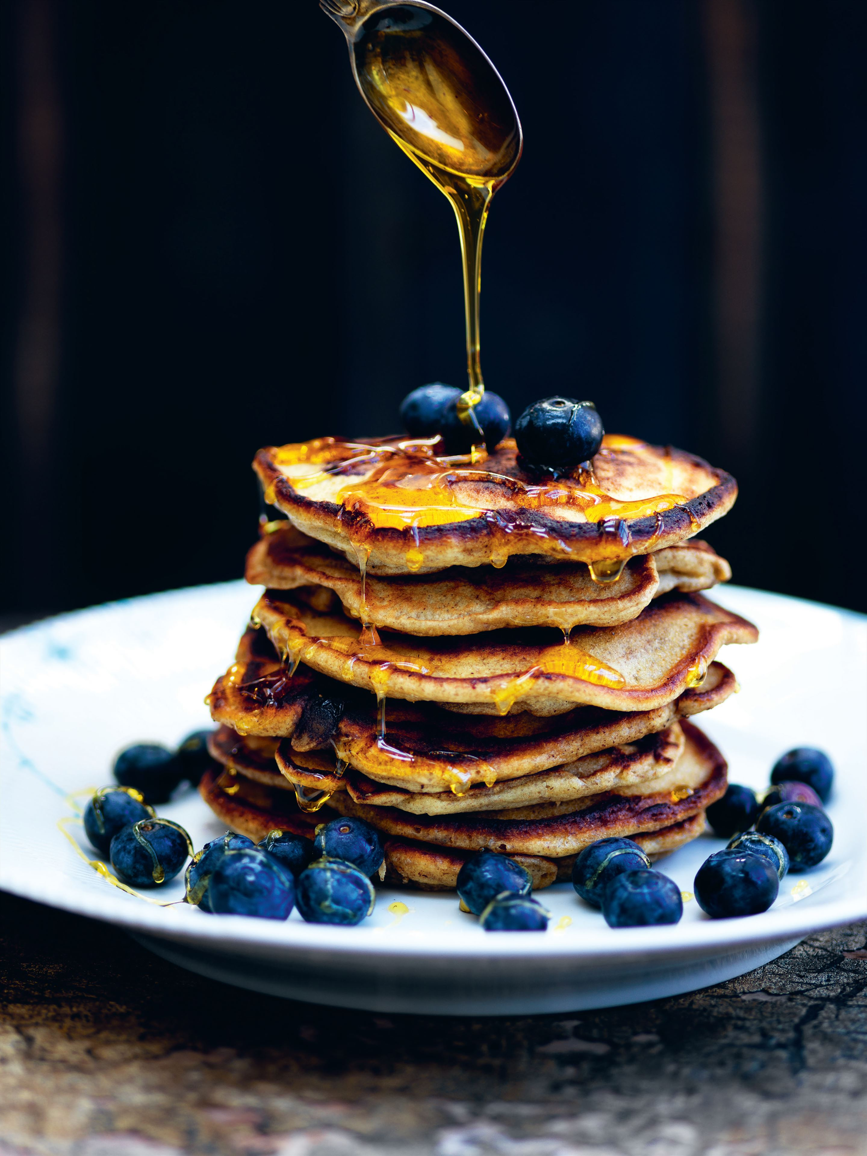 Rye pancakes with blueberries and golden syrup