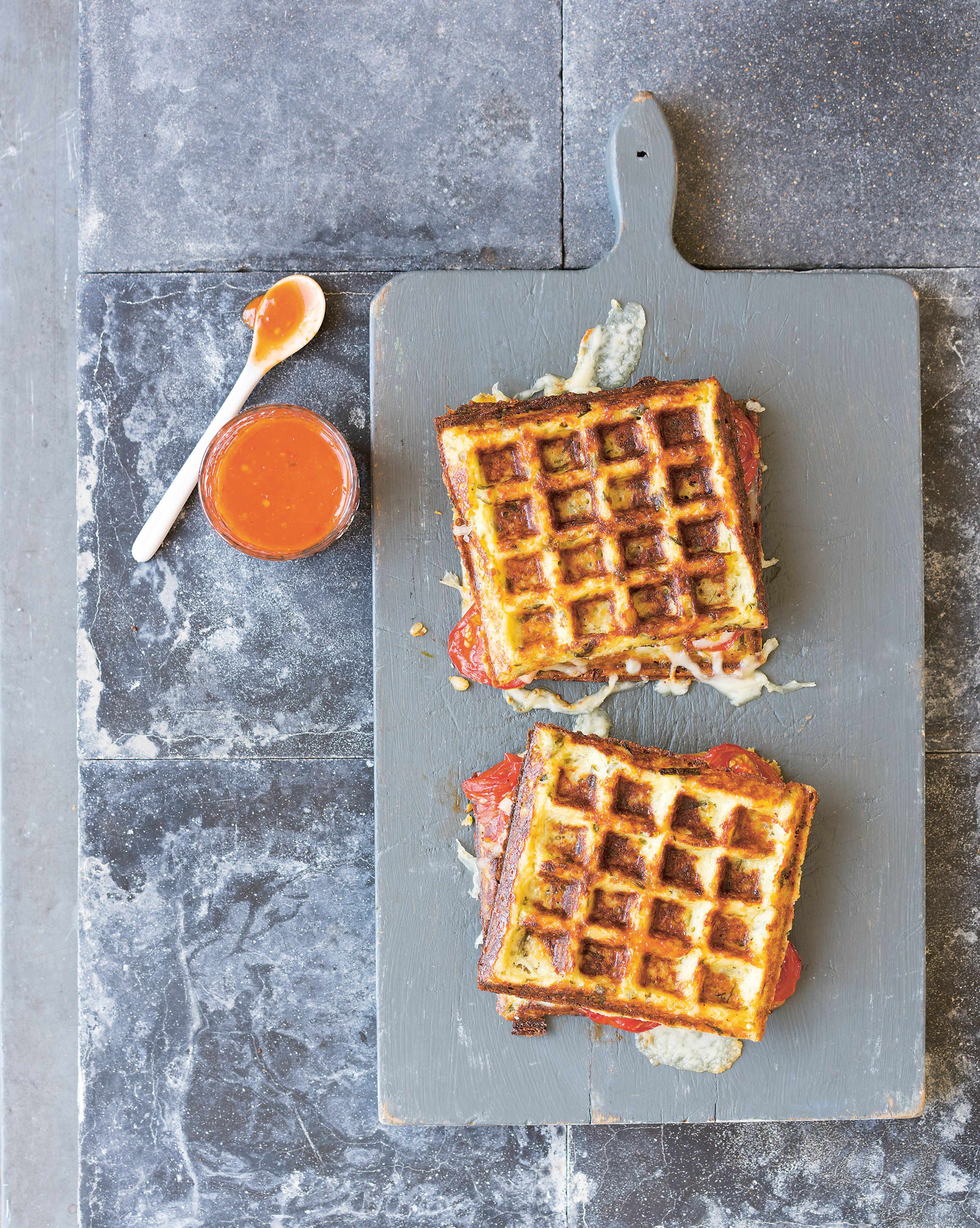 Cauliflower waffles with slow-roasted tomatoes & cheese