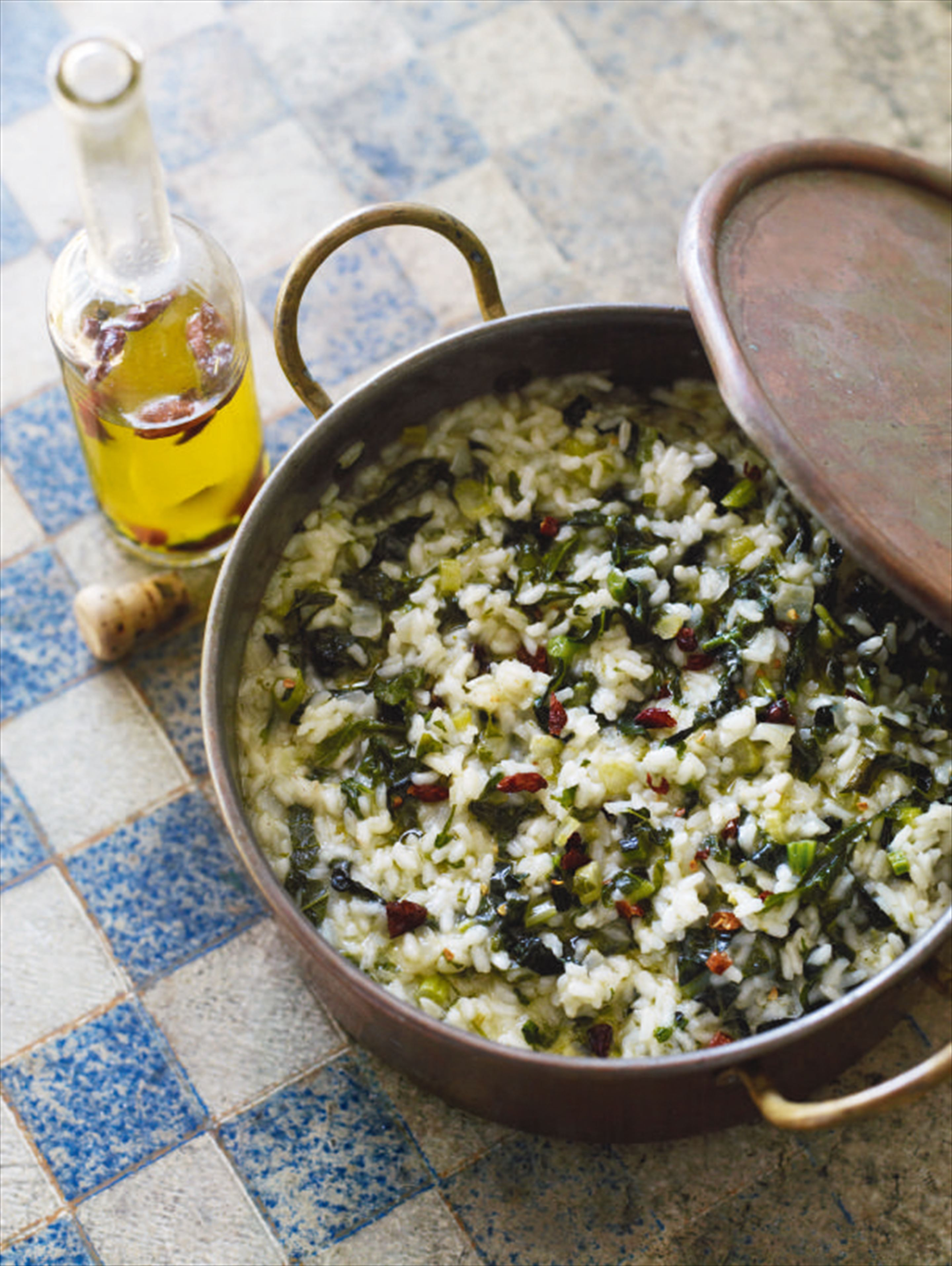 Garlic and turnip green rice with piri piri oil
